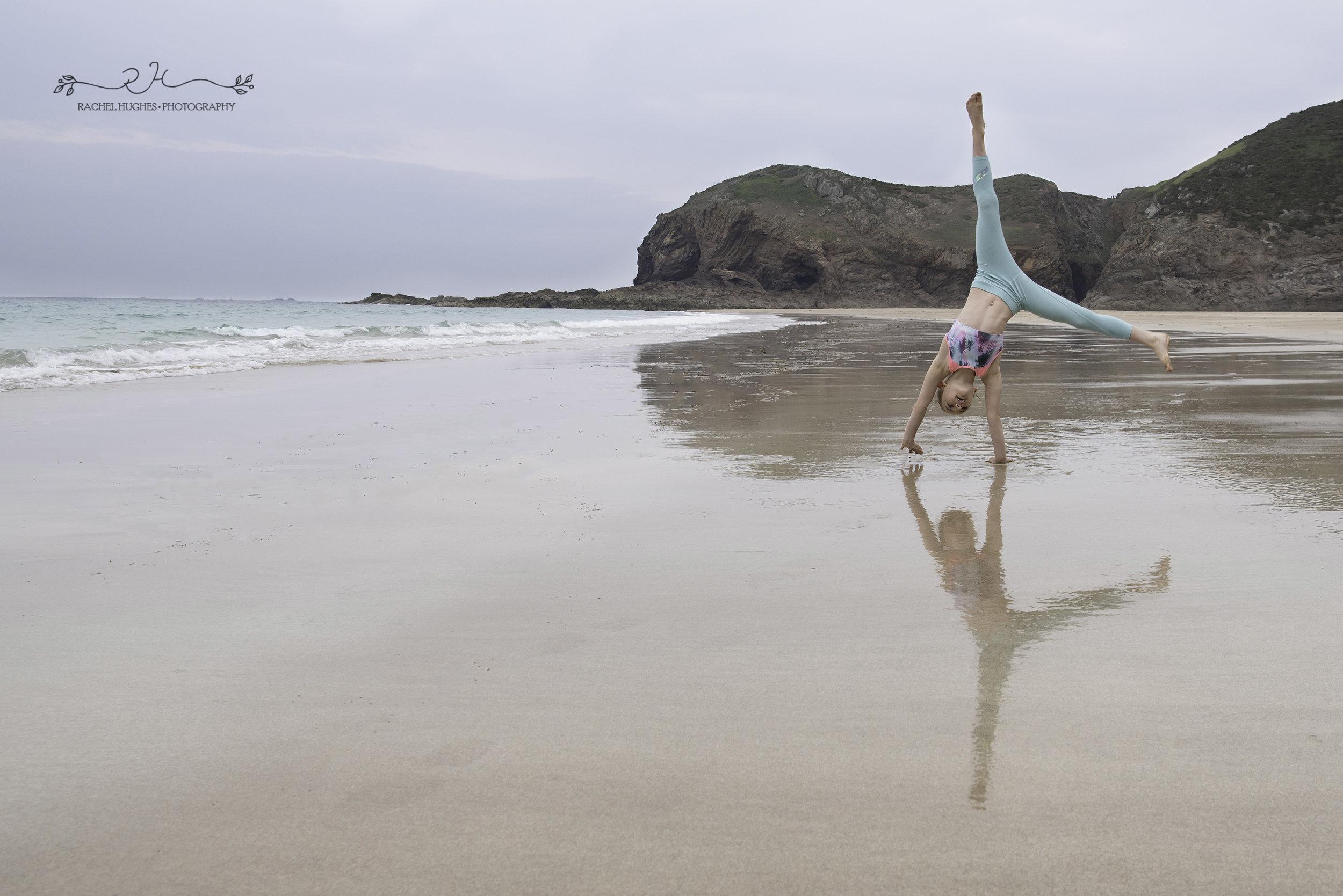 Jersey photographer - gymnast cartwheeling at Plemont
