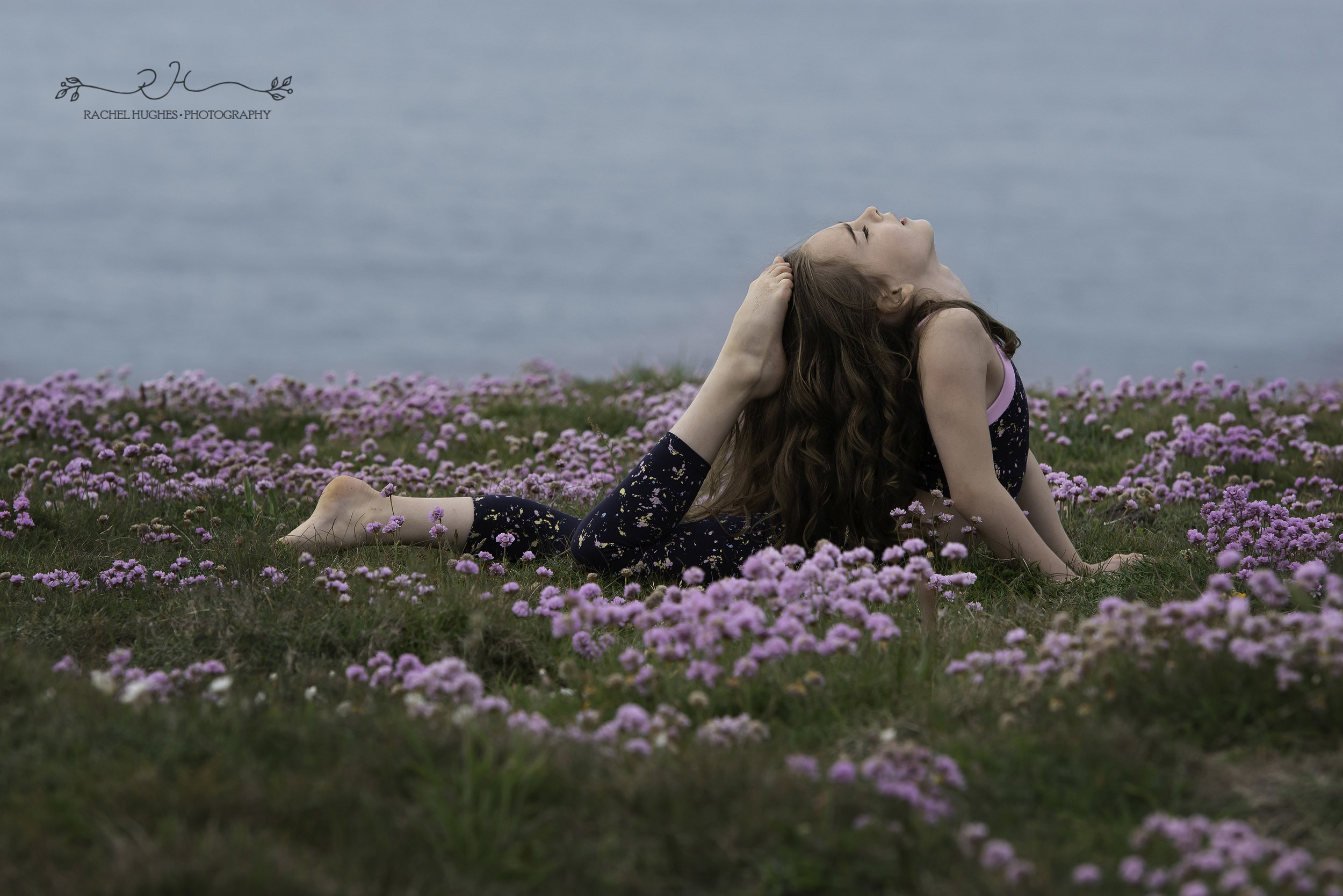Jersey photographer - gymnast touching head with toe at Grosnez castle