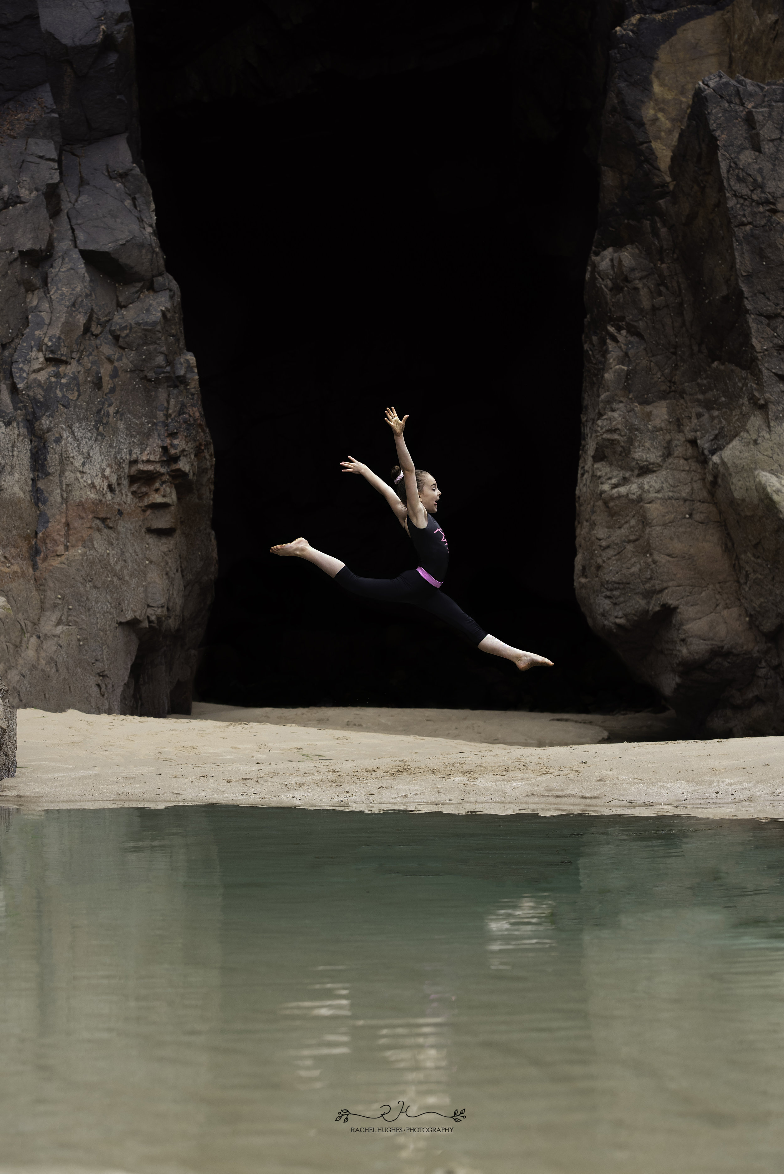 Jersey photographer - gymnast leaping in sea cave