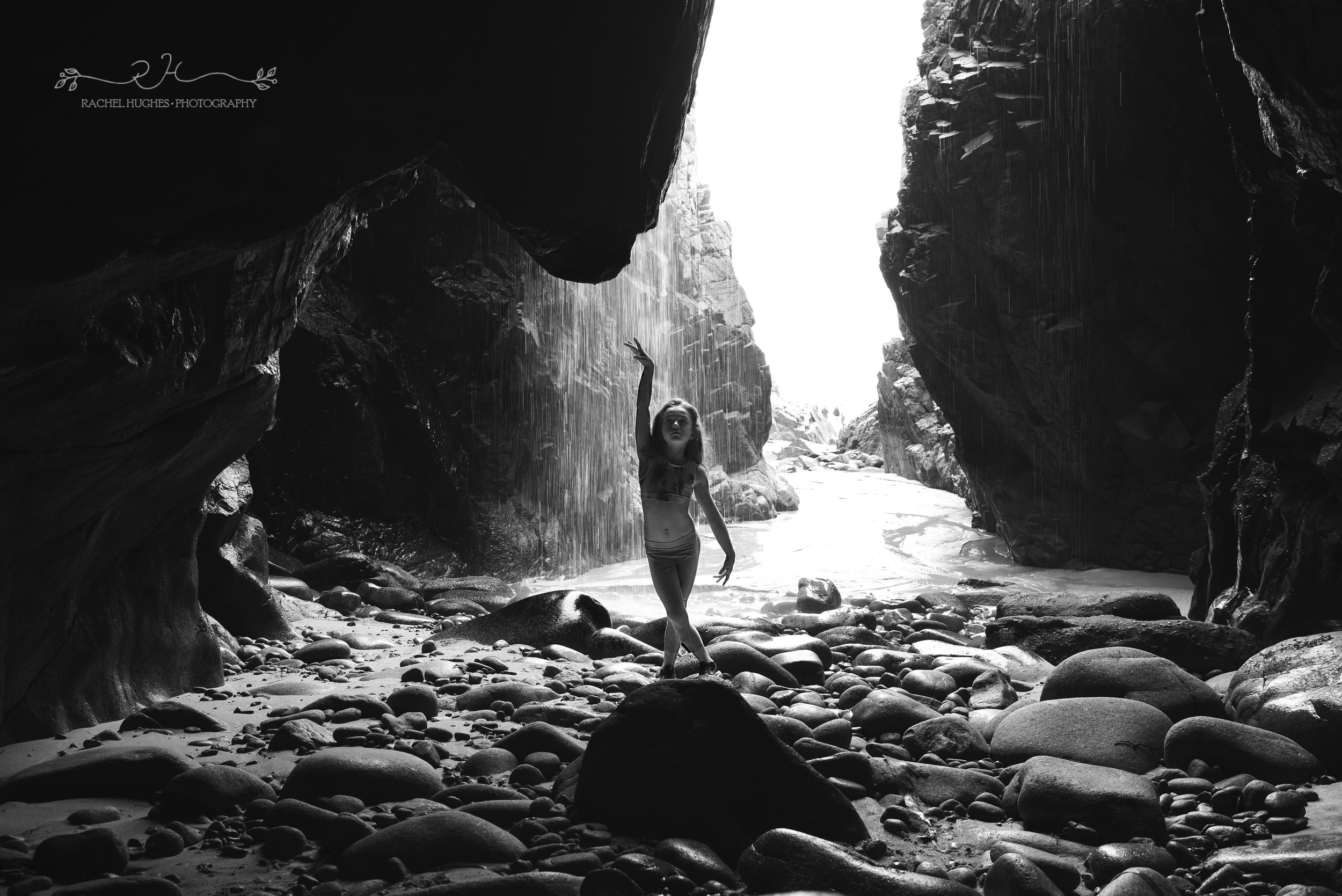Jersey photographer - gymnast in sea cave waterfall at Plemont