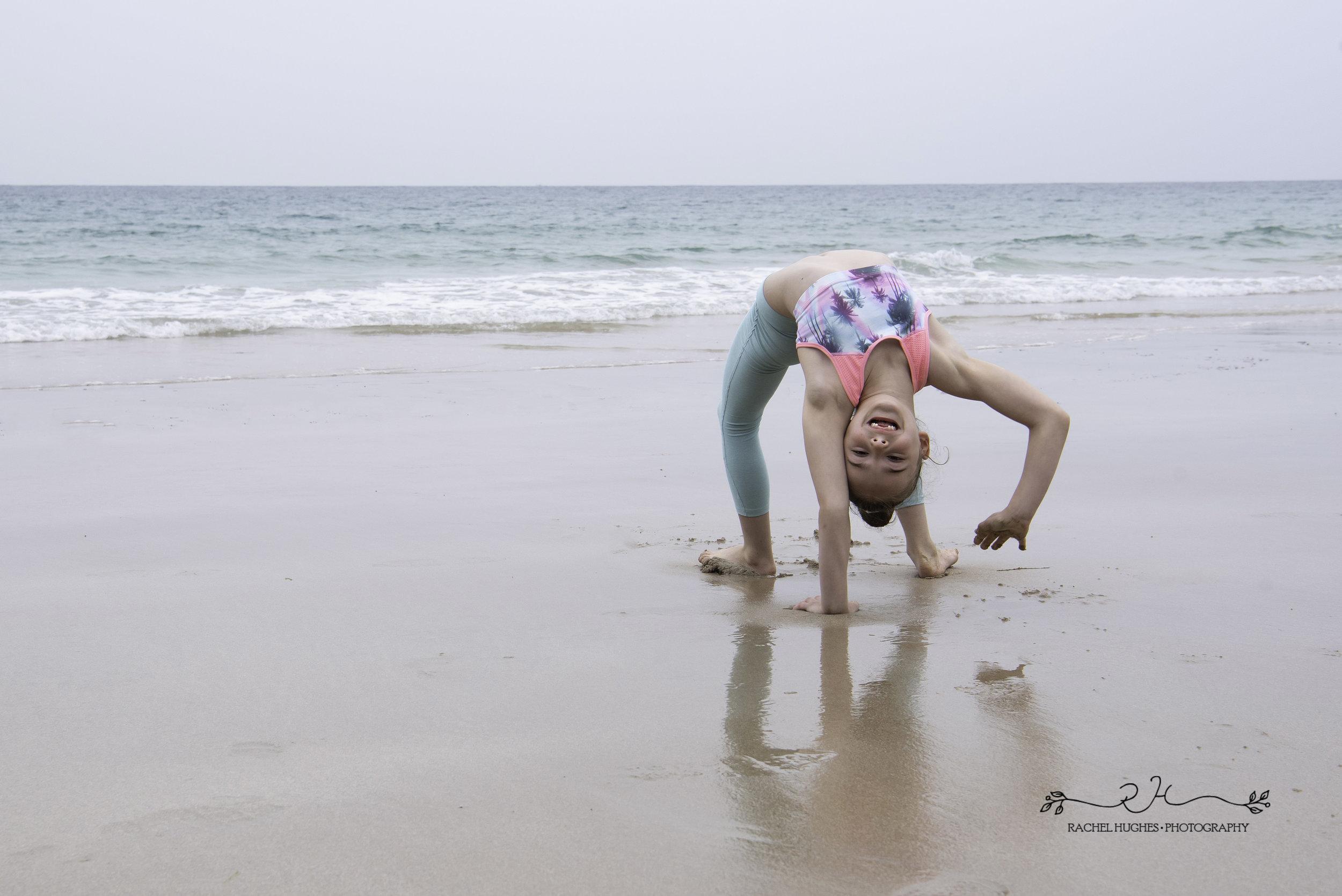 Jersey photographer - gymnast walking upside down at beach