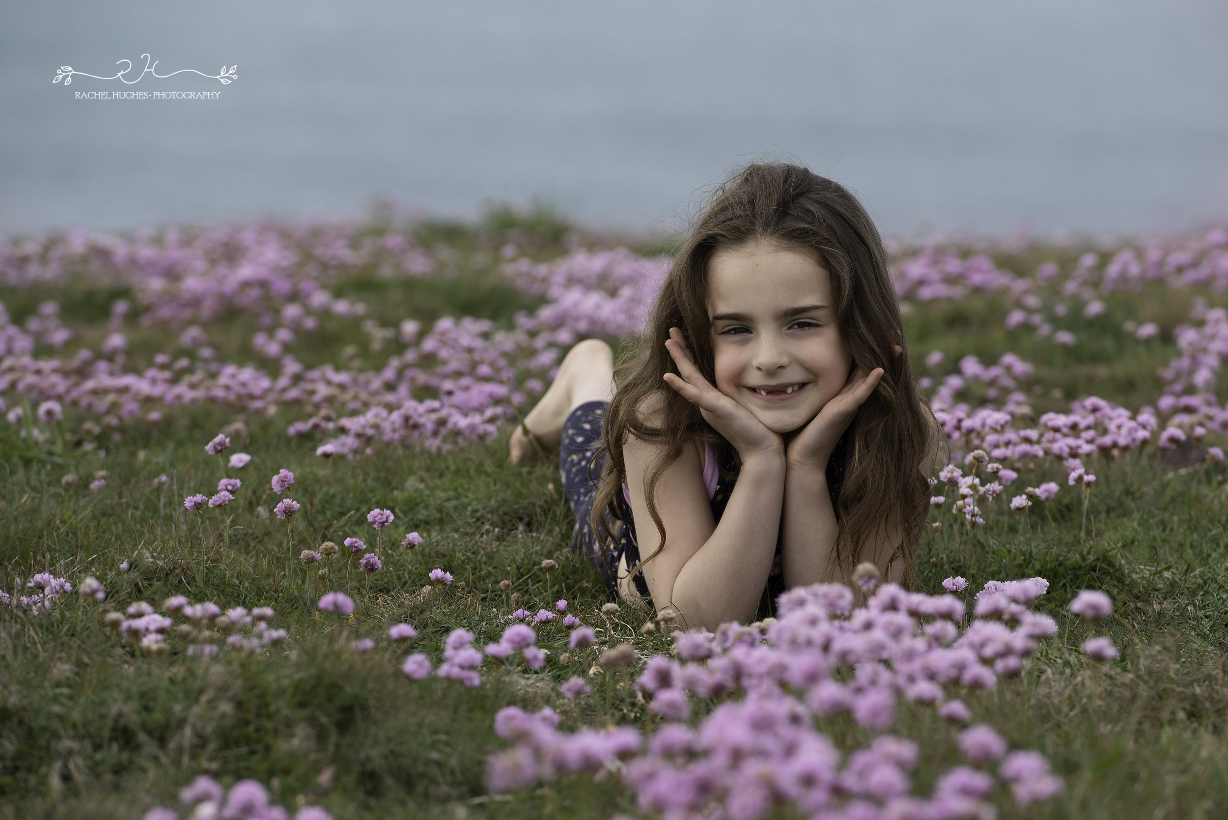 Jersey photographer - gymnast smiling in coastal flowers