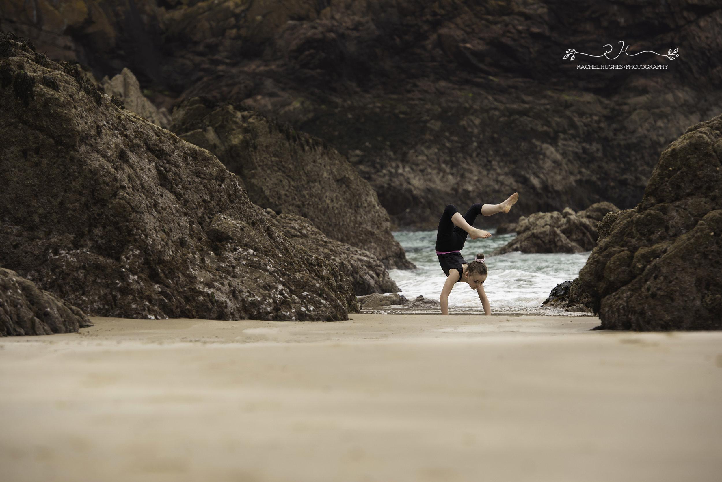 Jersey photographer - girl walking on hands at Plemont beach