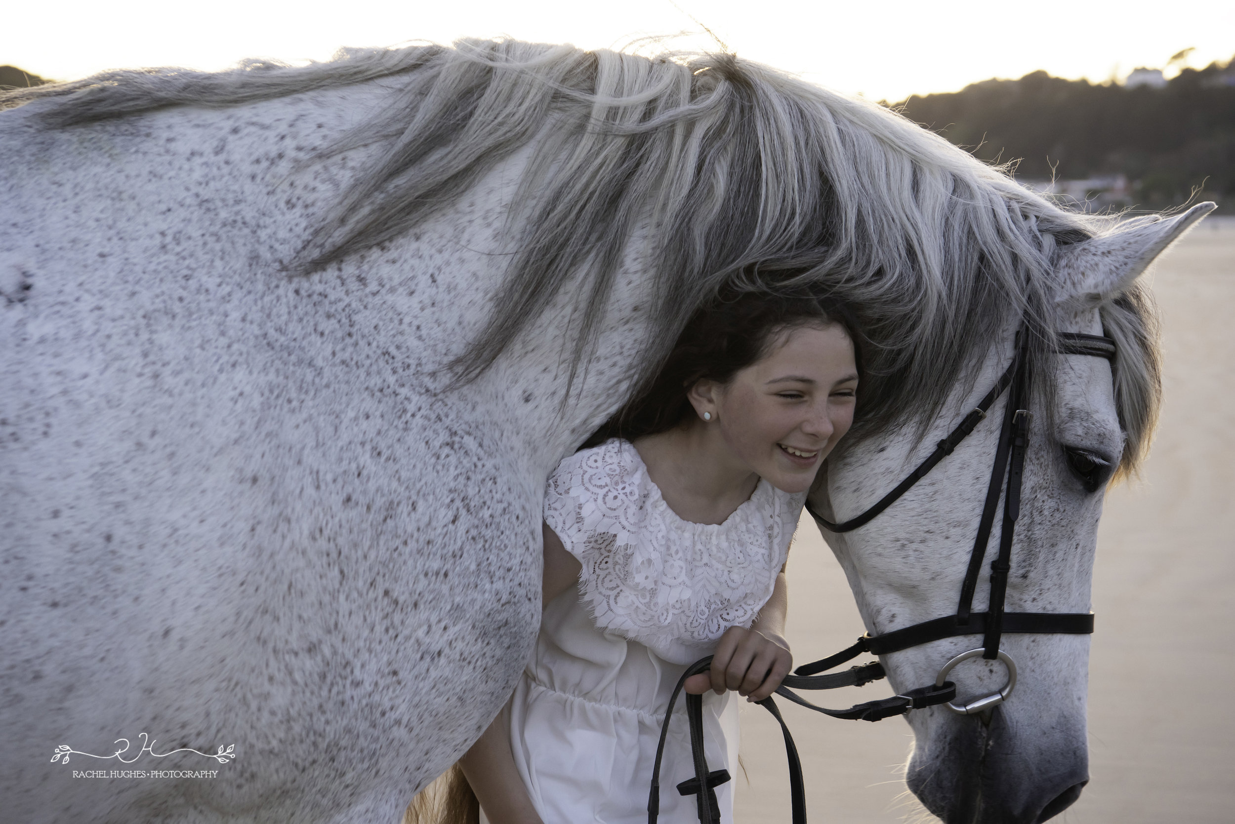 Jersey photographer - girl laughing with horse