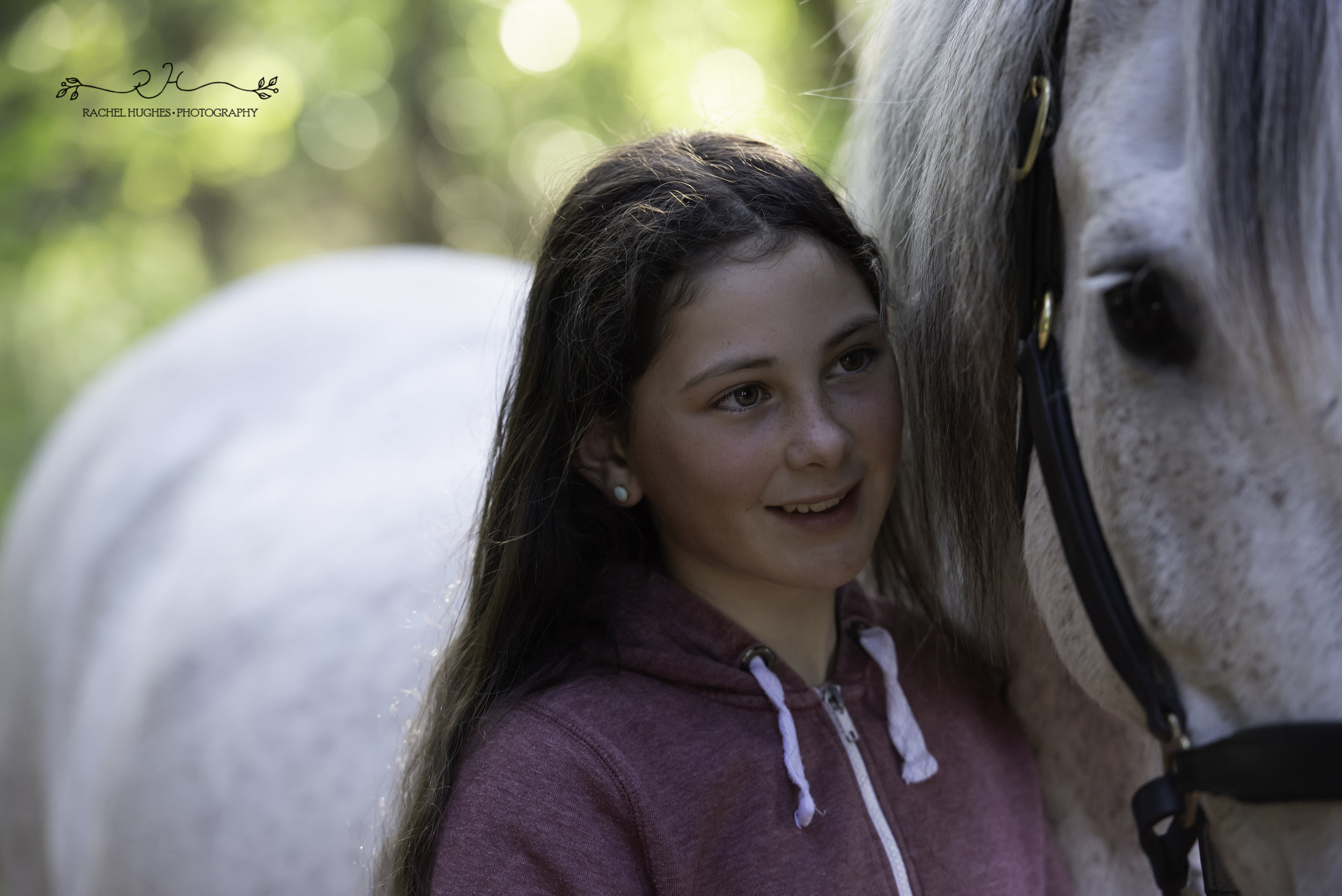 Jersey photographer - girl smiling at horse in Noirmont forest