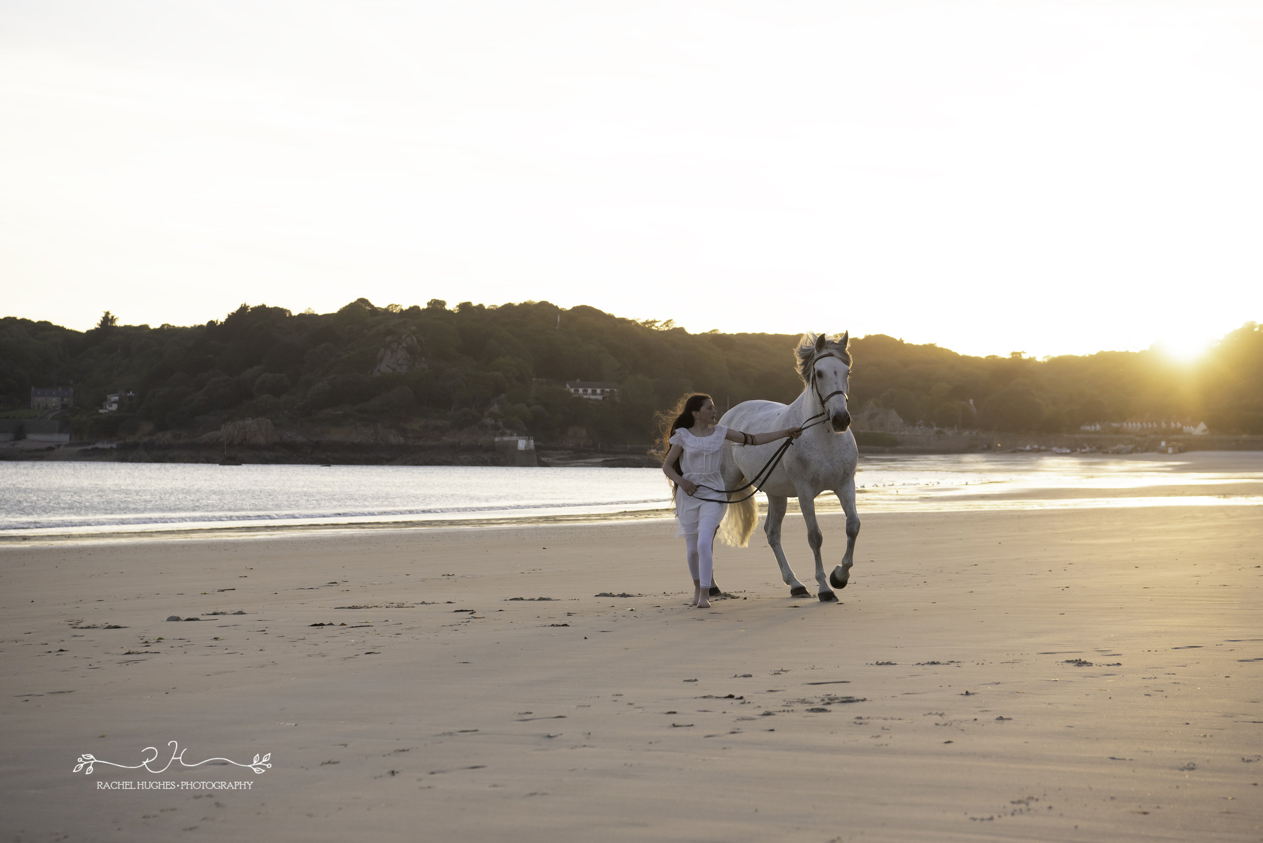 Jersey photographer - girl running alongside horse at St Brelades
