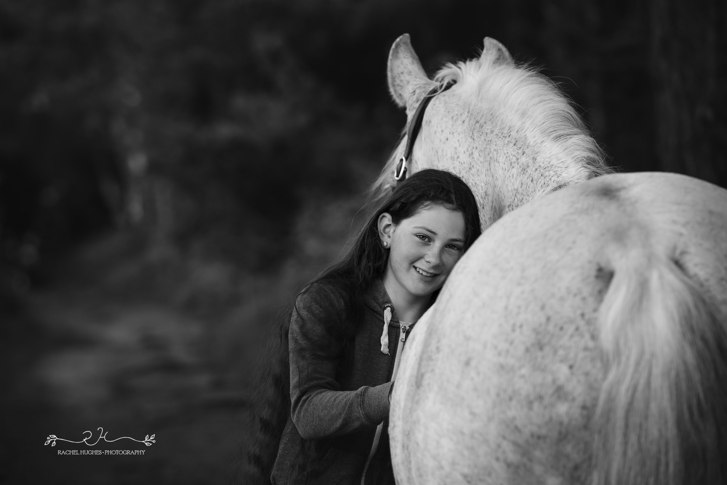 Jersey photographer - girl leaning into horse