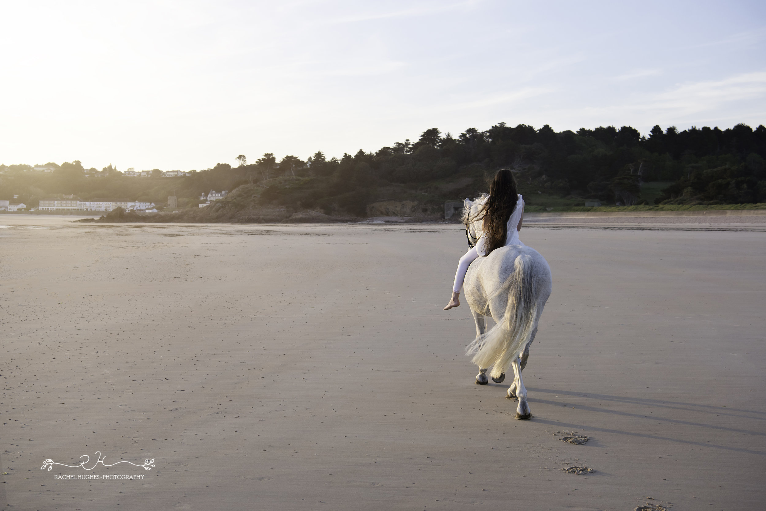 Jersey photographer  - girl and horse riding into sunset