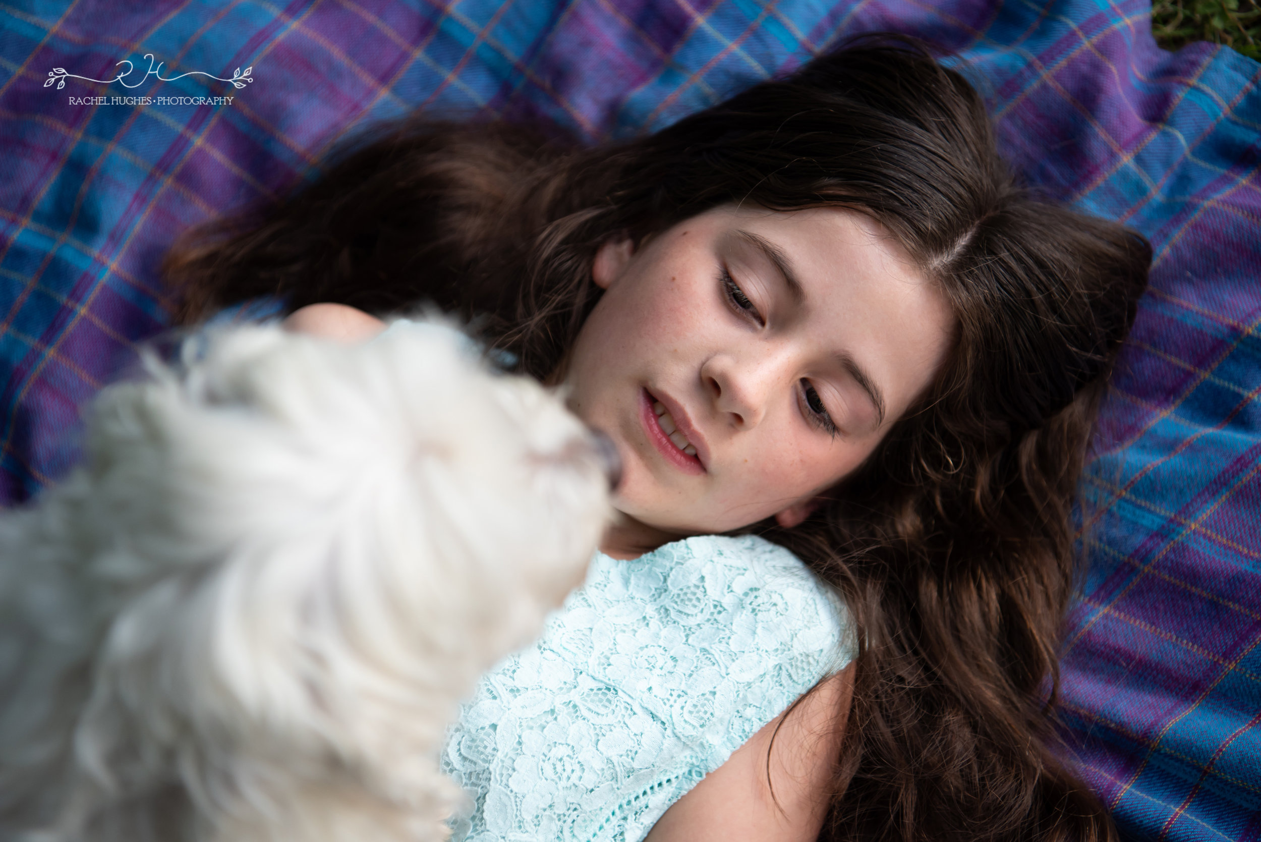Jersey photographer - girl lying on blanket with her dog