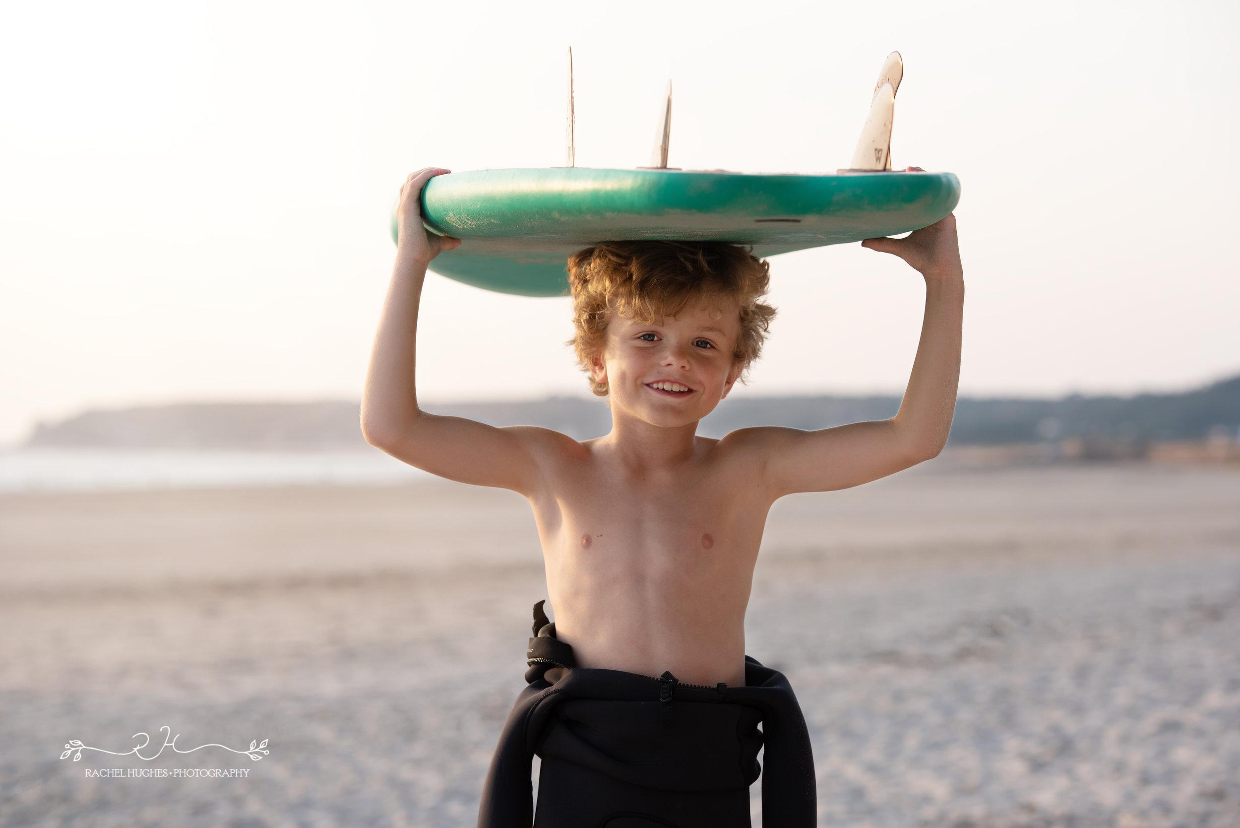 Jersey photographer - boy holding surfboard