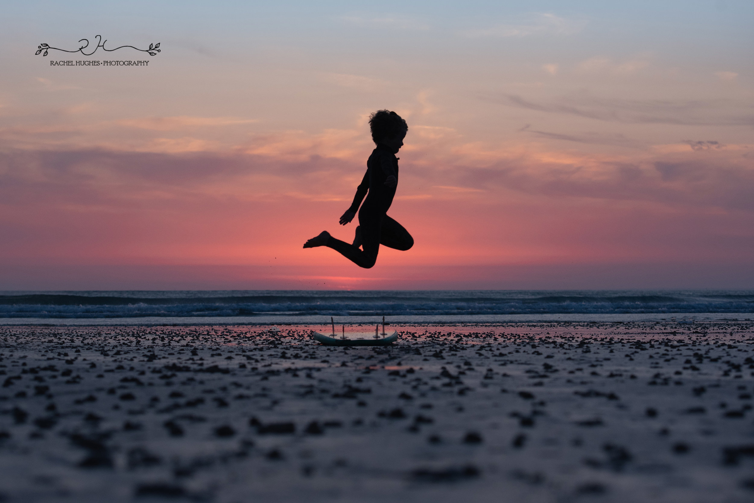 Jersey photographer - boy jumping over surfboard at sunset