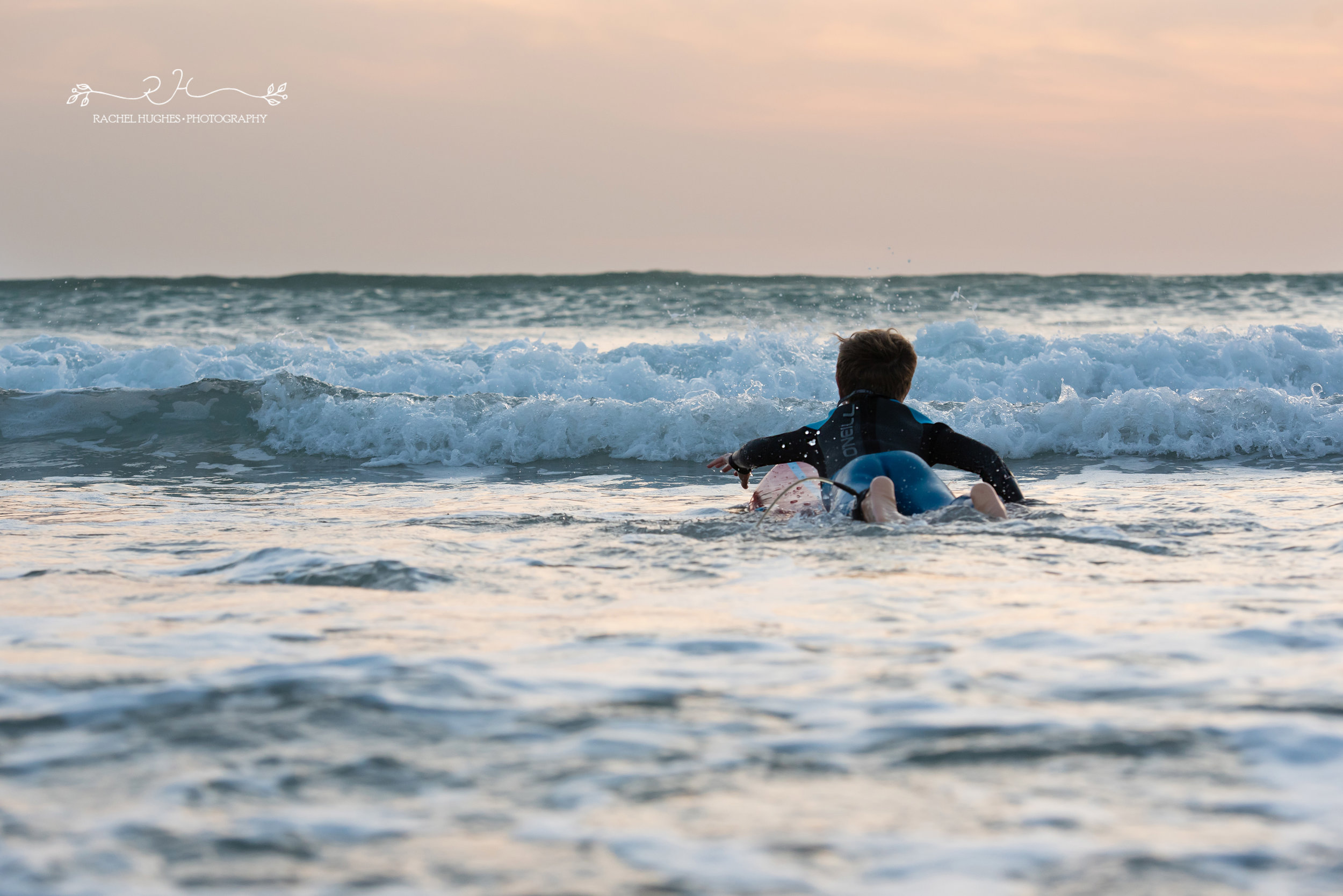 Jersey photographer - boy paddling out to surf