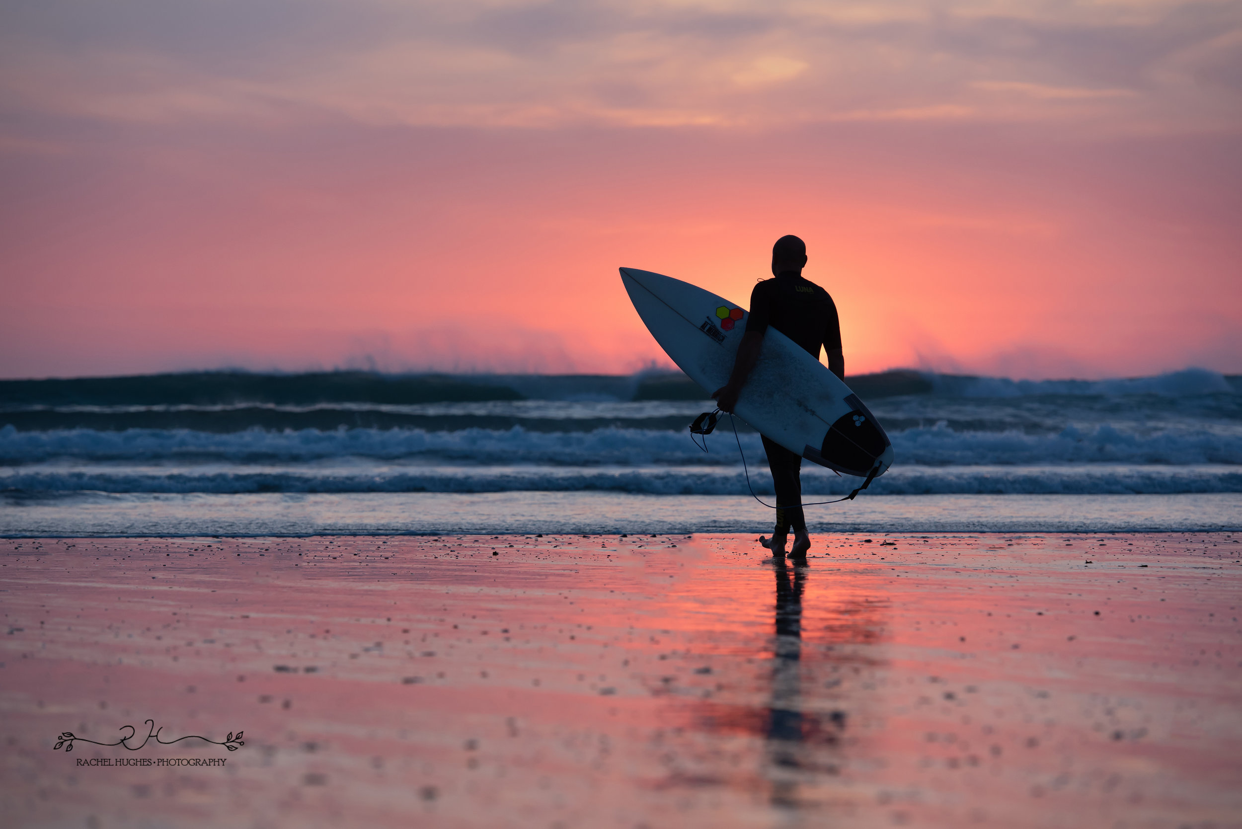 Jersey photographer - surfer at sunset at St Ouens
