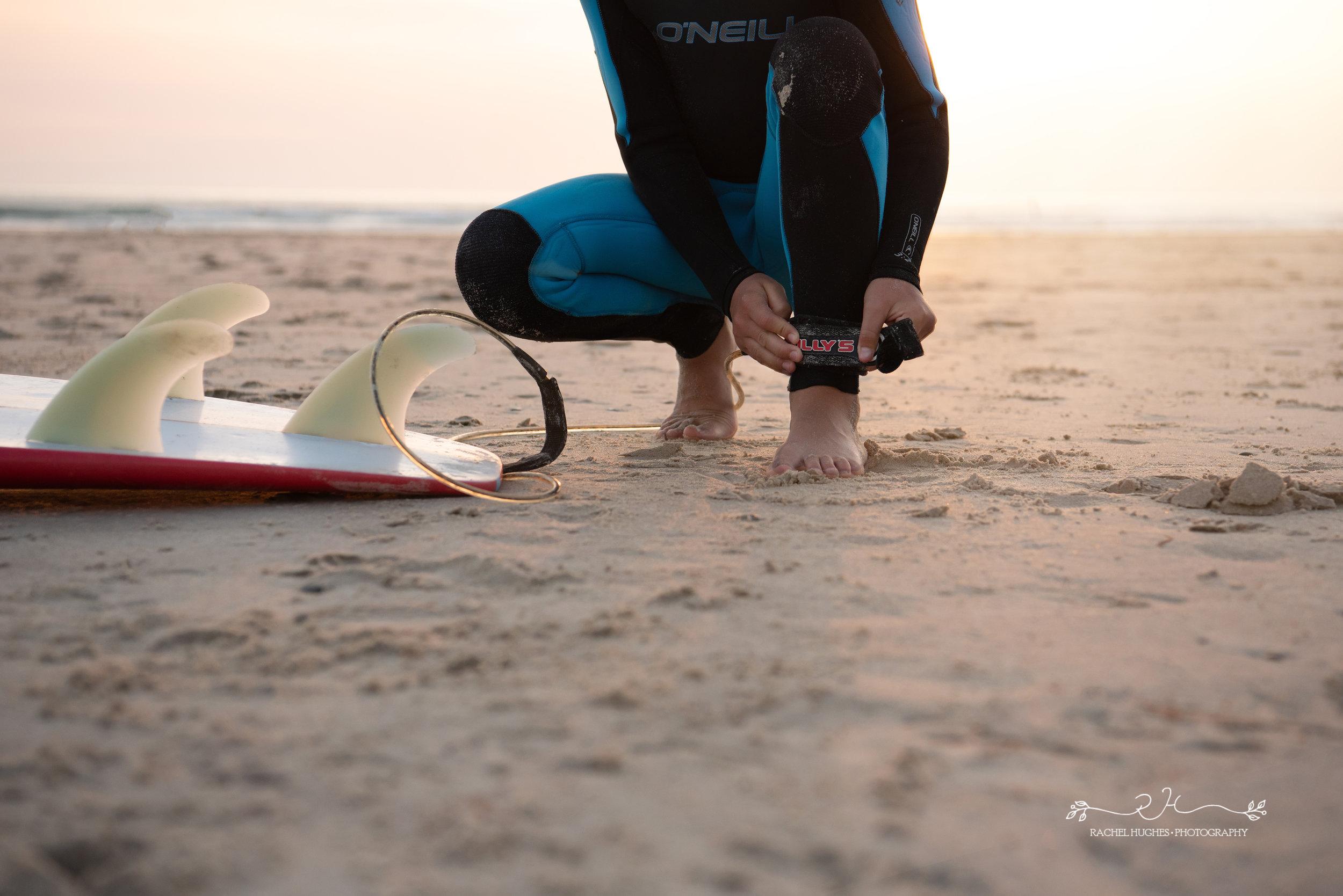 Jersey photographer - boy attaching surfboard leash