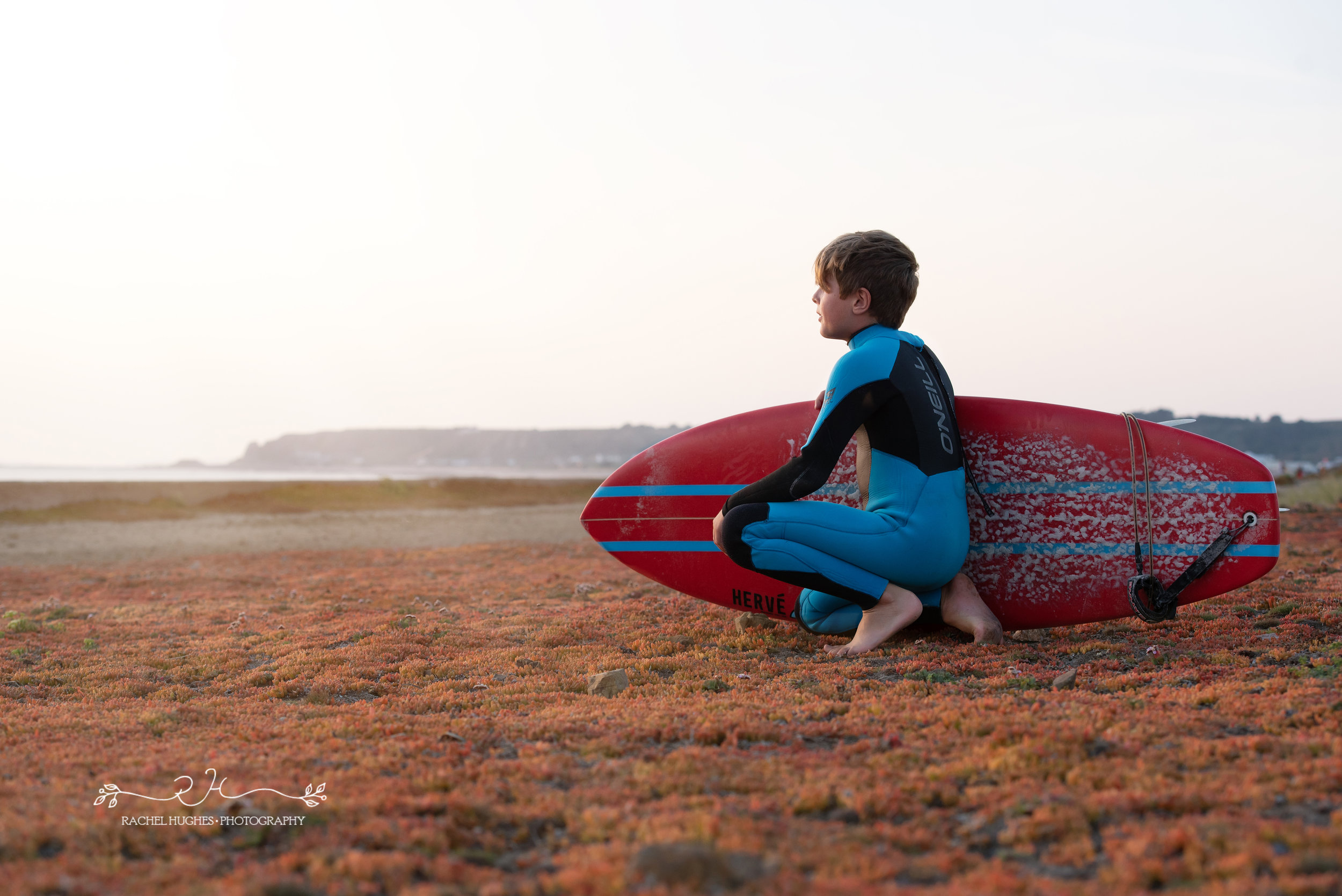 Jersey photographer - boy looking at surf waves