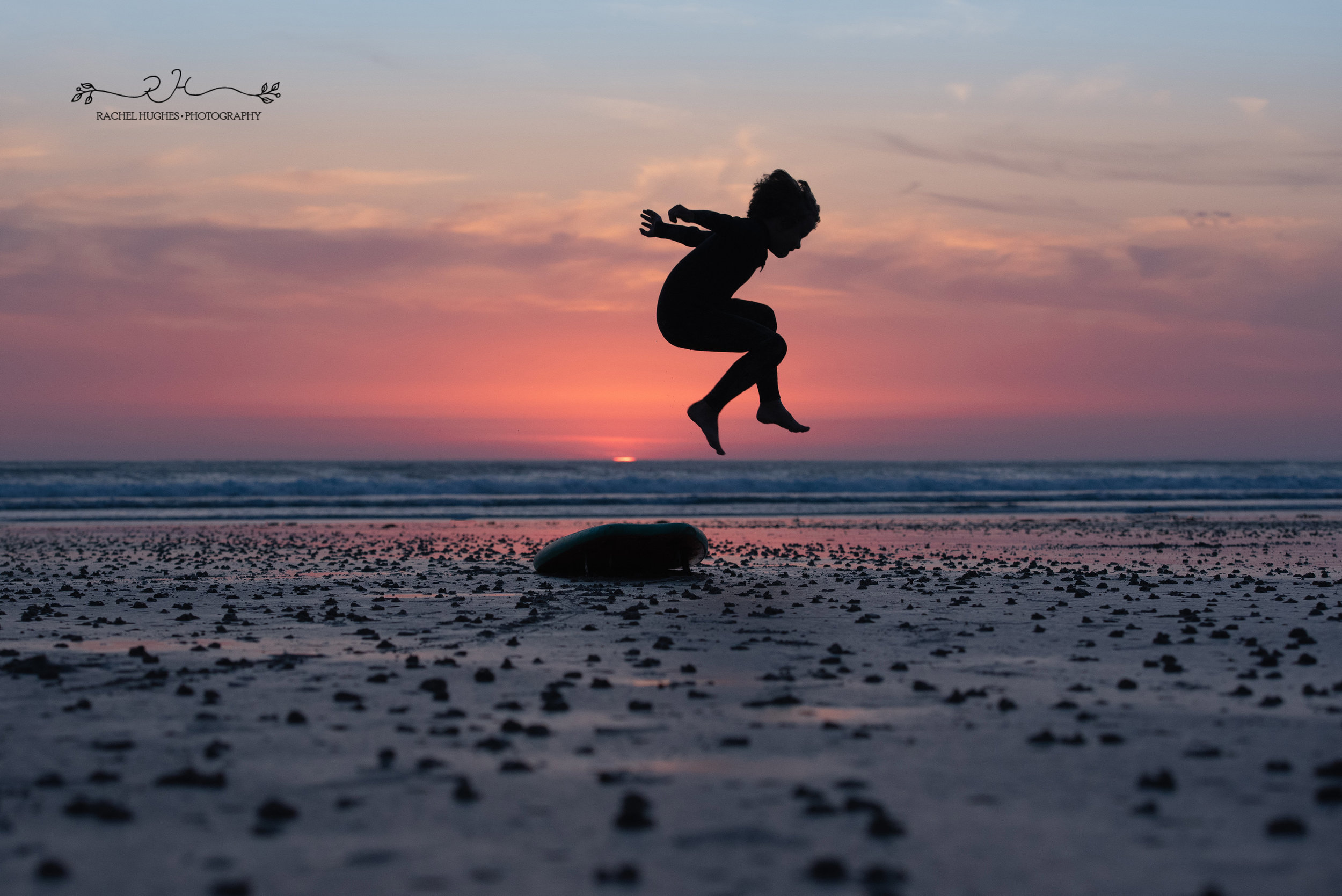 Jersey photographer - boy leaping over surfboard