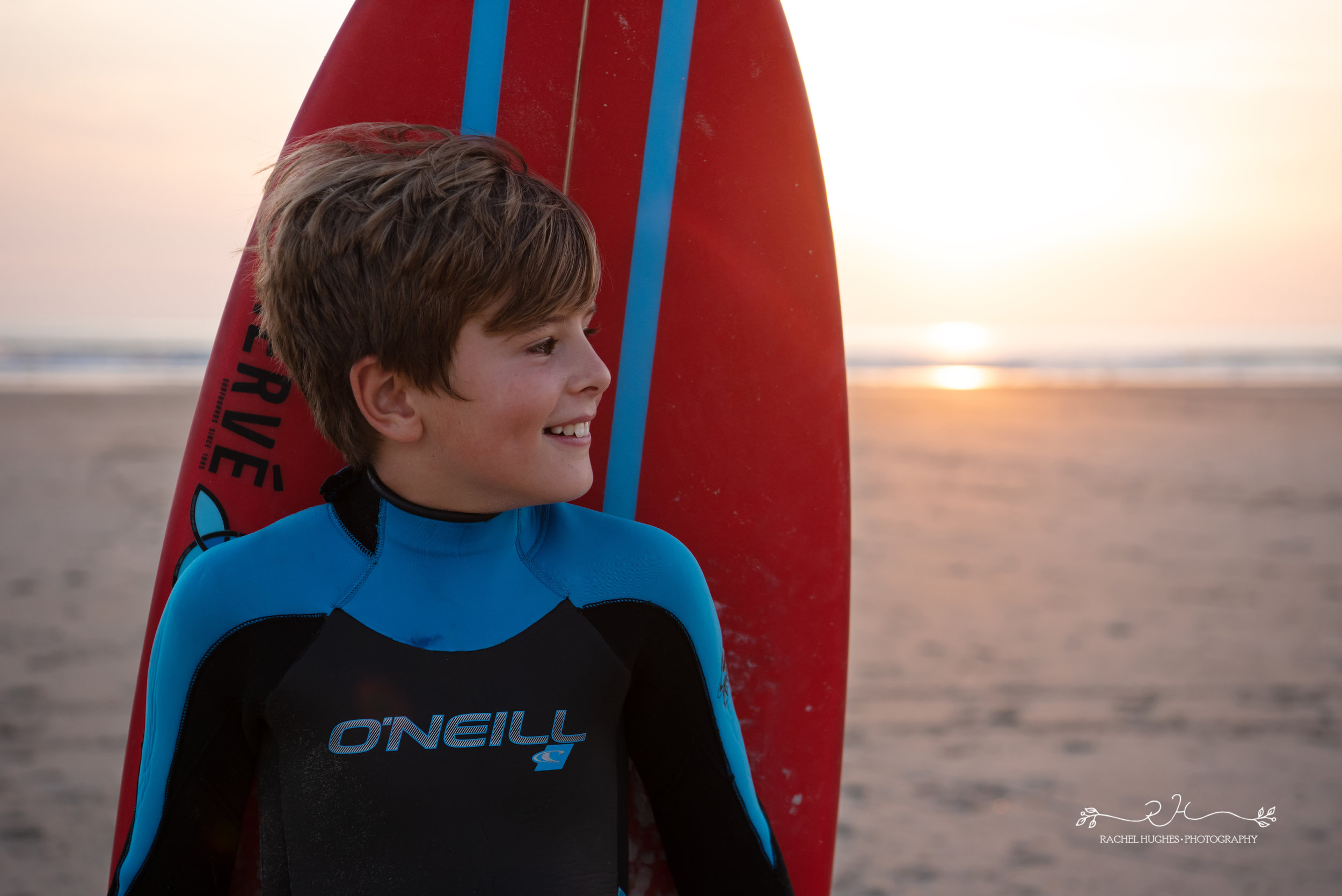 Jersey photographer - boy with surfboard on back