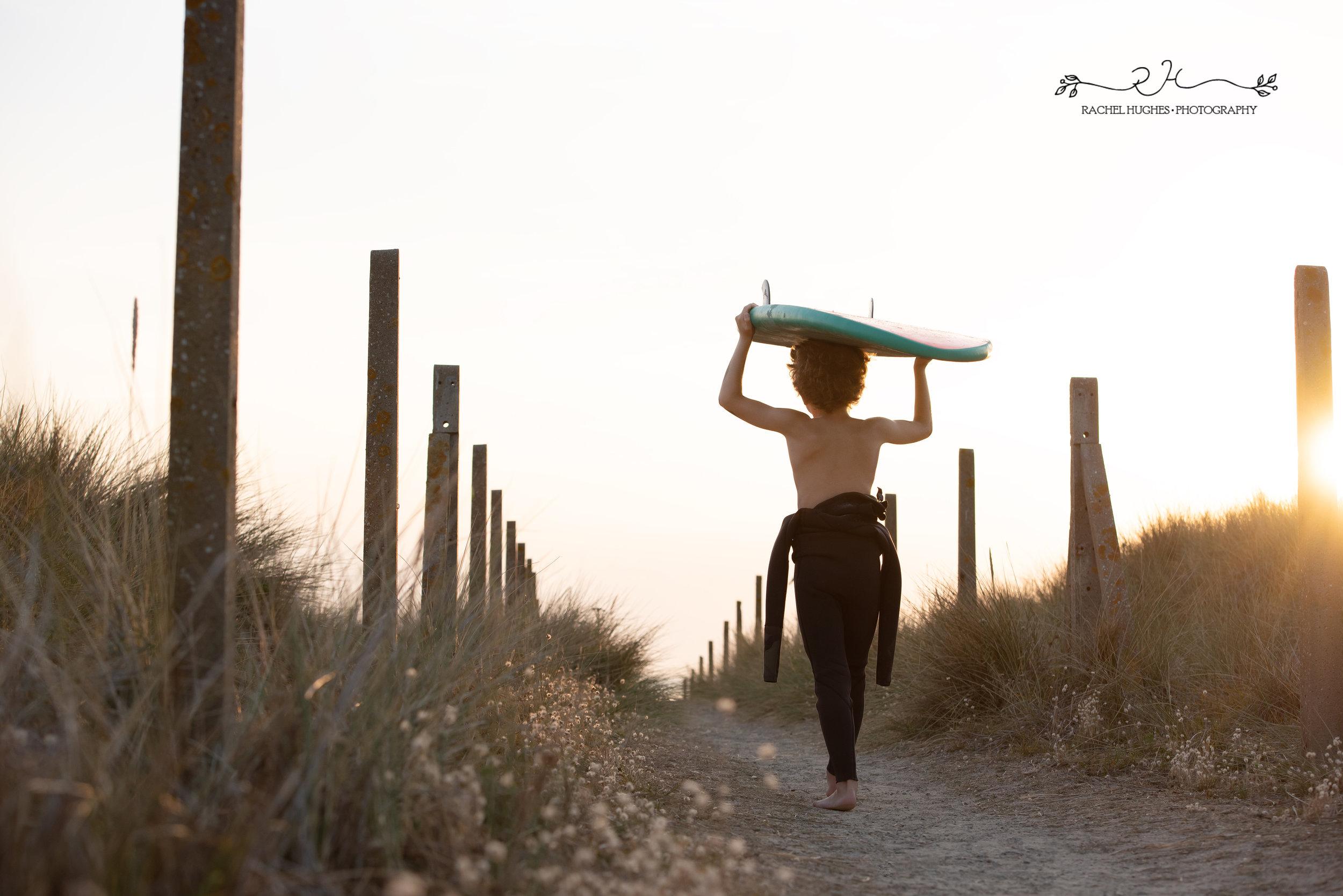 Jersey photographer - surfer boy heading into sunset