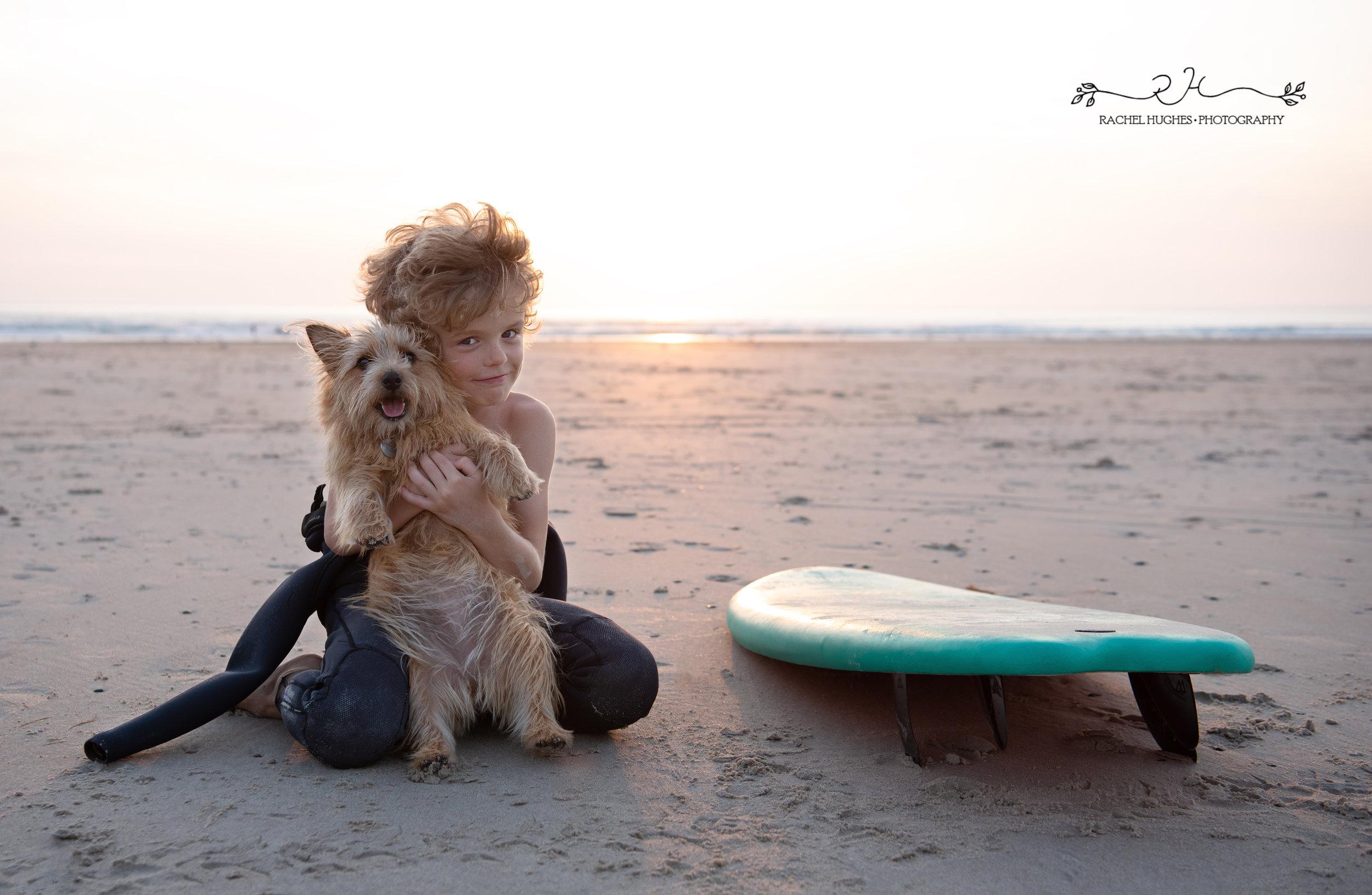Jersey photographer - surfer boy cuddling dog