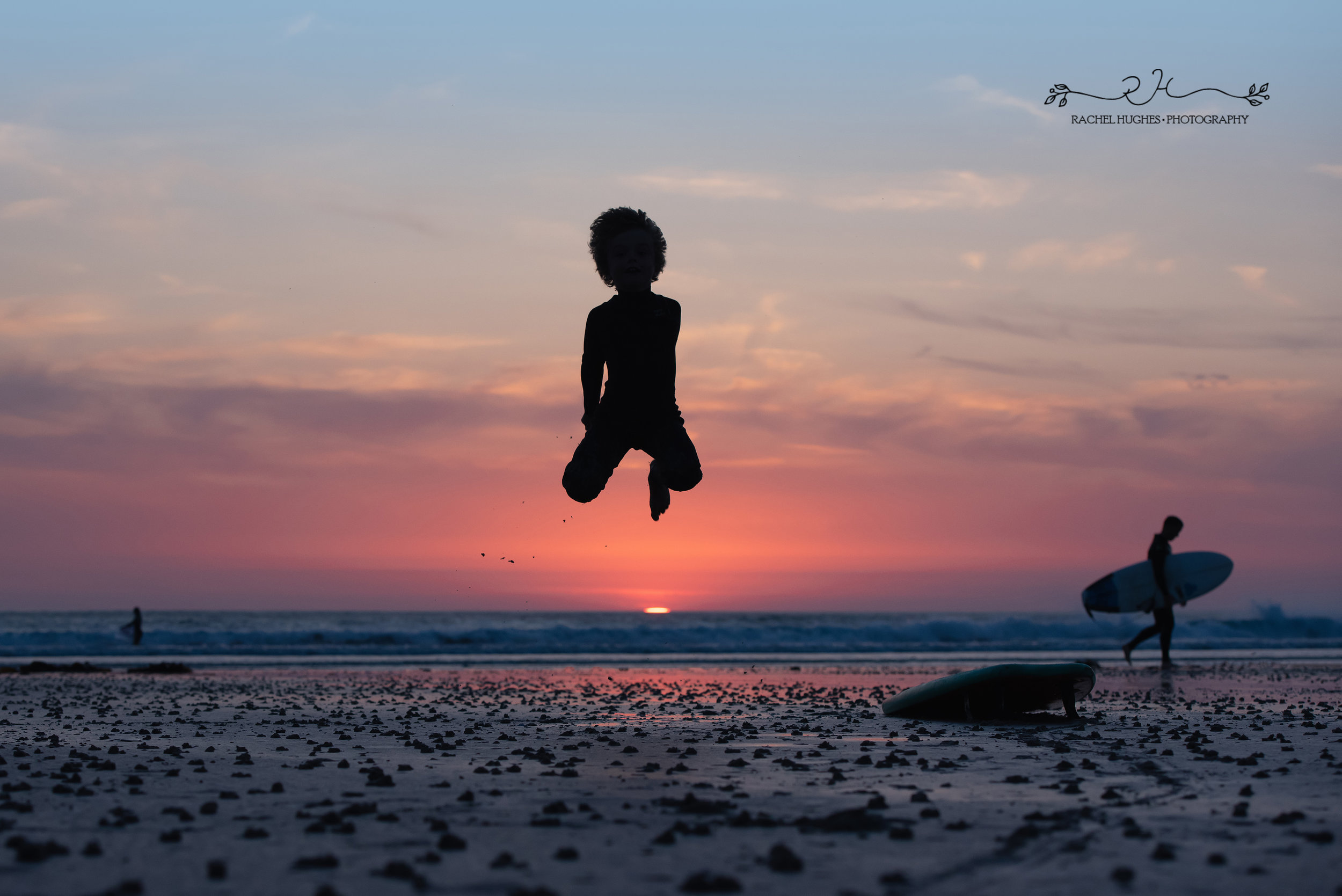Jersey photographer - surfer boy leaping high at sunset