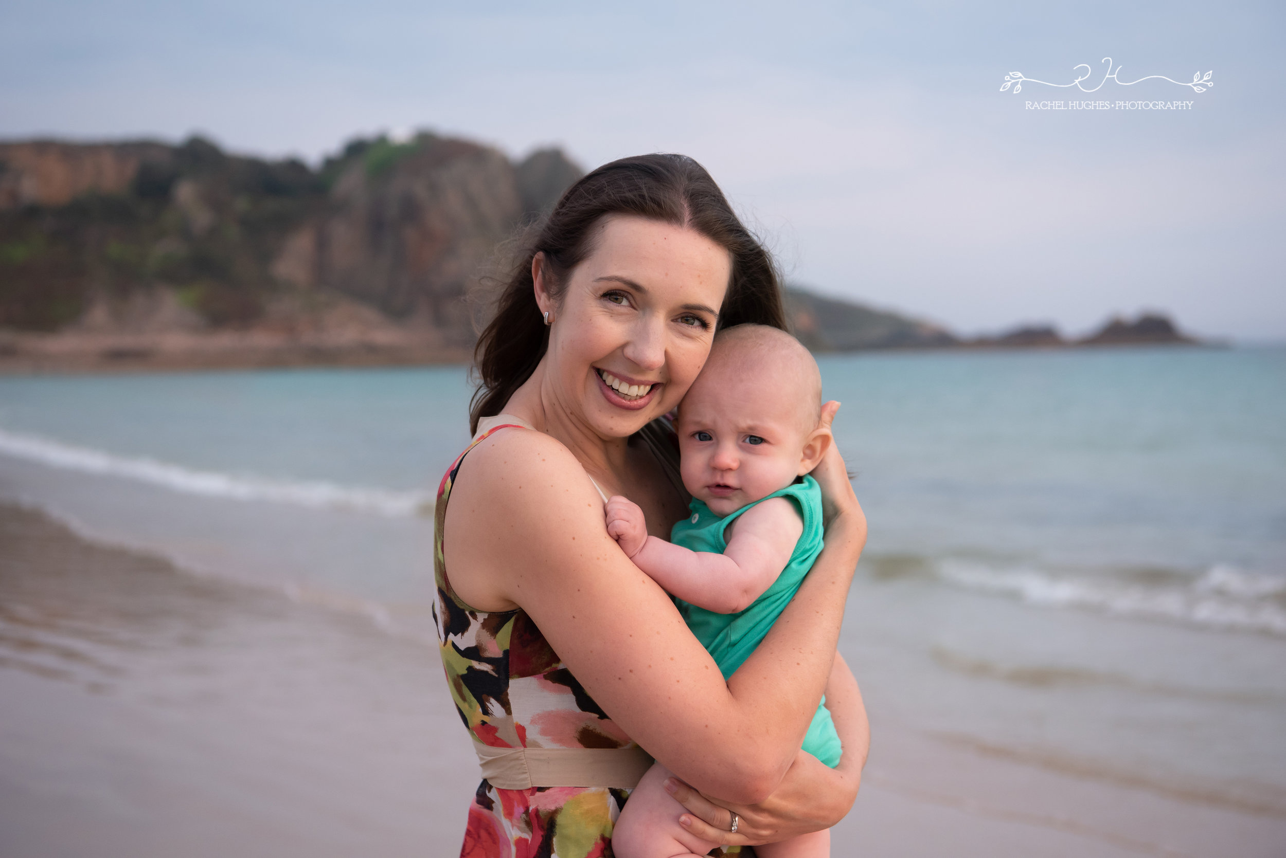 Jersey photographer - baby in mum's arms at Ouaisne