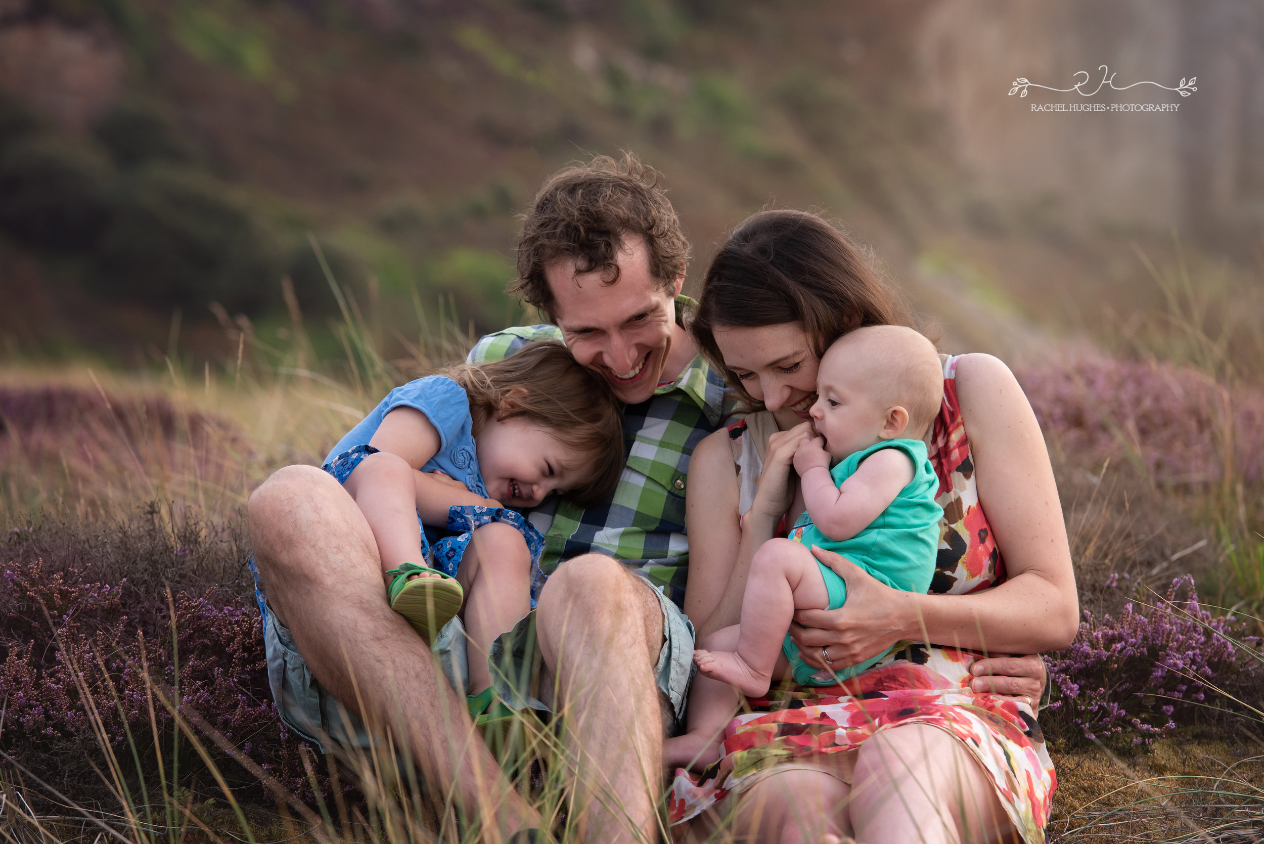 Jersey photographer - family cuddling at Ouaisne Bay
