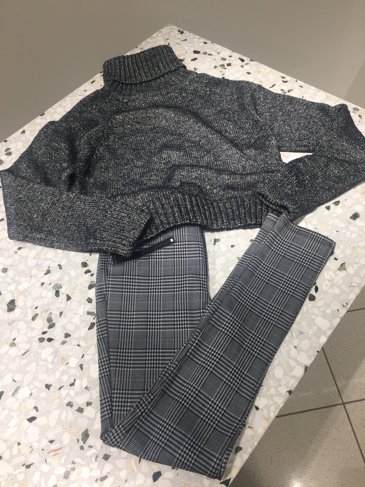 Simple, classic and chic; you can't go wrong with a slim slack in a trendy plaid print and a cozy turtleneck. Paired with a black booty or simple black leather sneaker, this outfit works for the 9 to 5 and for running errands on the weekend. Outfit from Nordstrom.