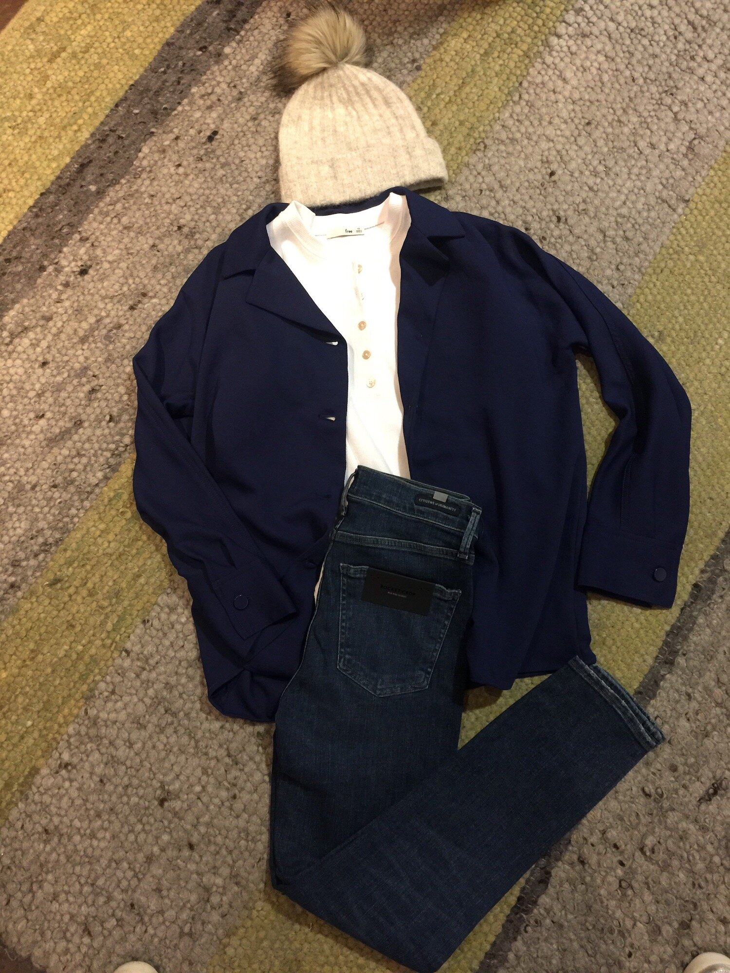 Jeans work for the office; just make sure they're your best pair in a slim fit in a medium or dark wash.  This outfit would be perfect for casual Friday paired with a leather lace-up brogue.  We've styled these dark Citizen jeans with a white shirt and loose navy shirt jacket.  Outfit from Aritzia.