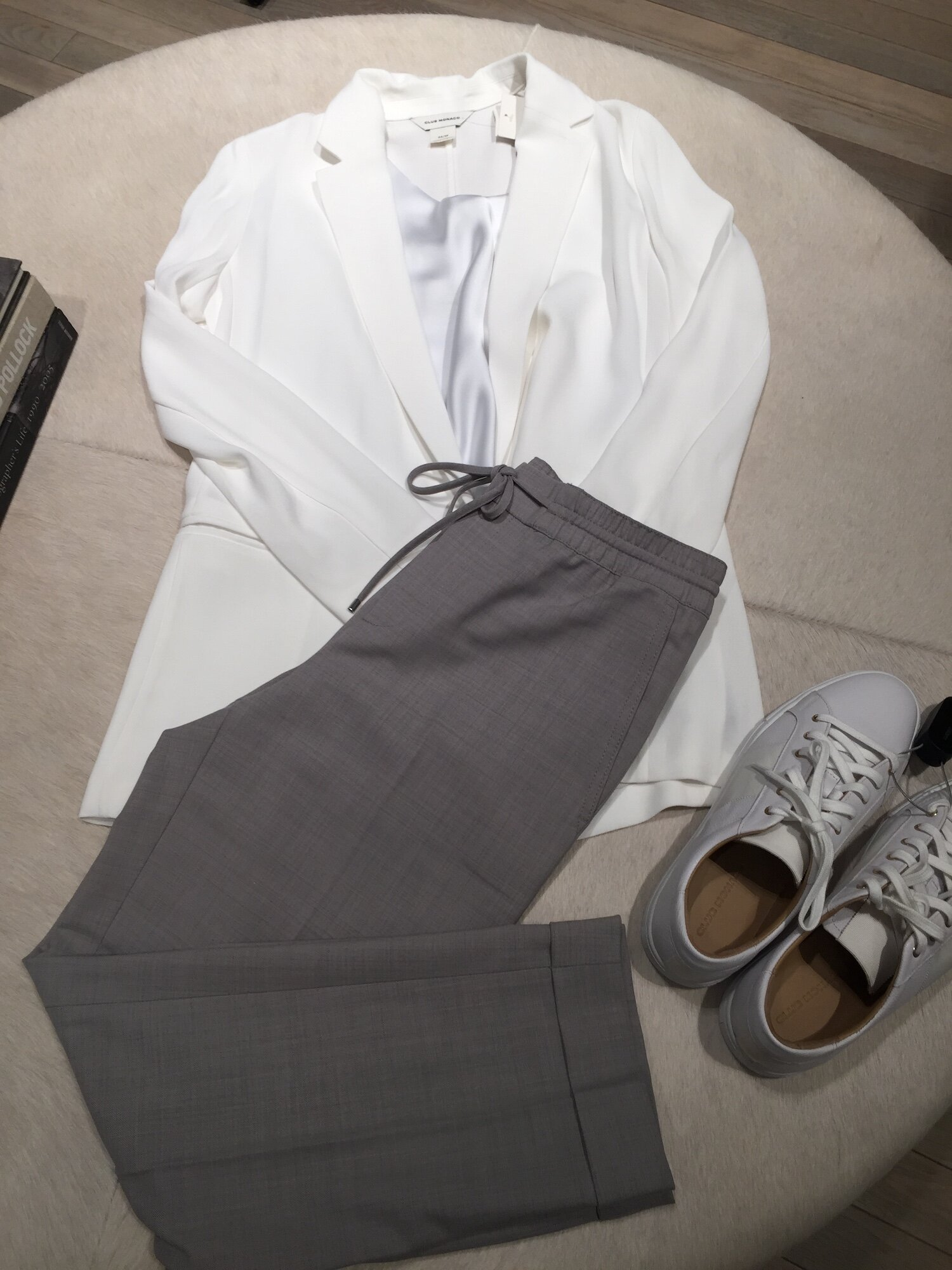 While blazers usually scream 'office', this one is unstructured making it a perfect choice. Paired with a simple grey wool loose slack and white kicks, it's a comfortable yet chic office look. Switch out the blazer for a simple black turtleneck for weekend brunch. Outfit from Club Monaco.