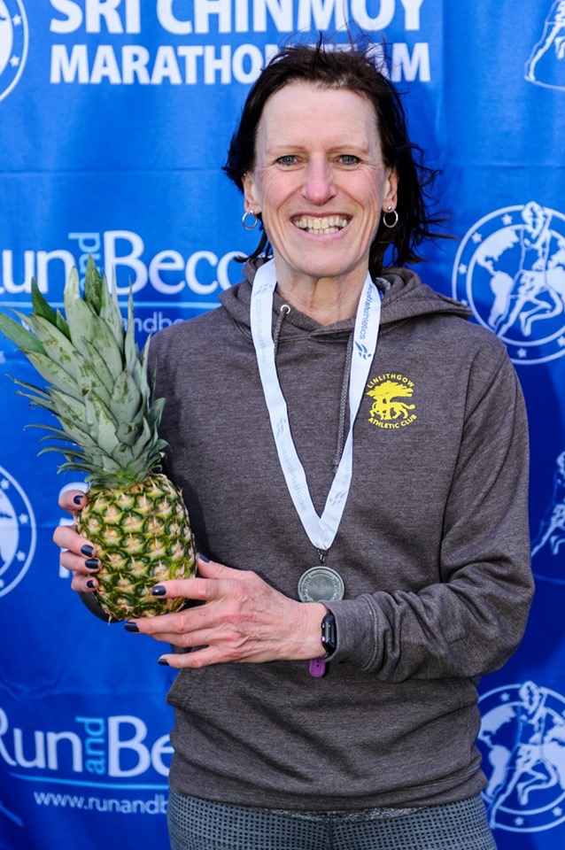 Frances with her medal and pineapple! - Photo by Bobby Gavin, Scottish Athletics