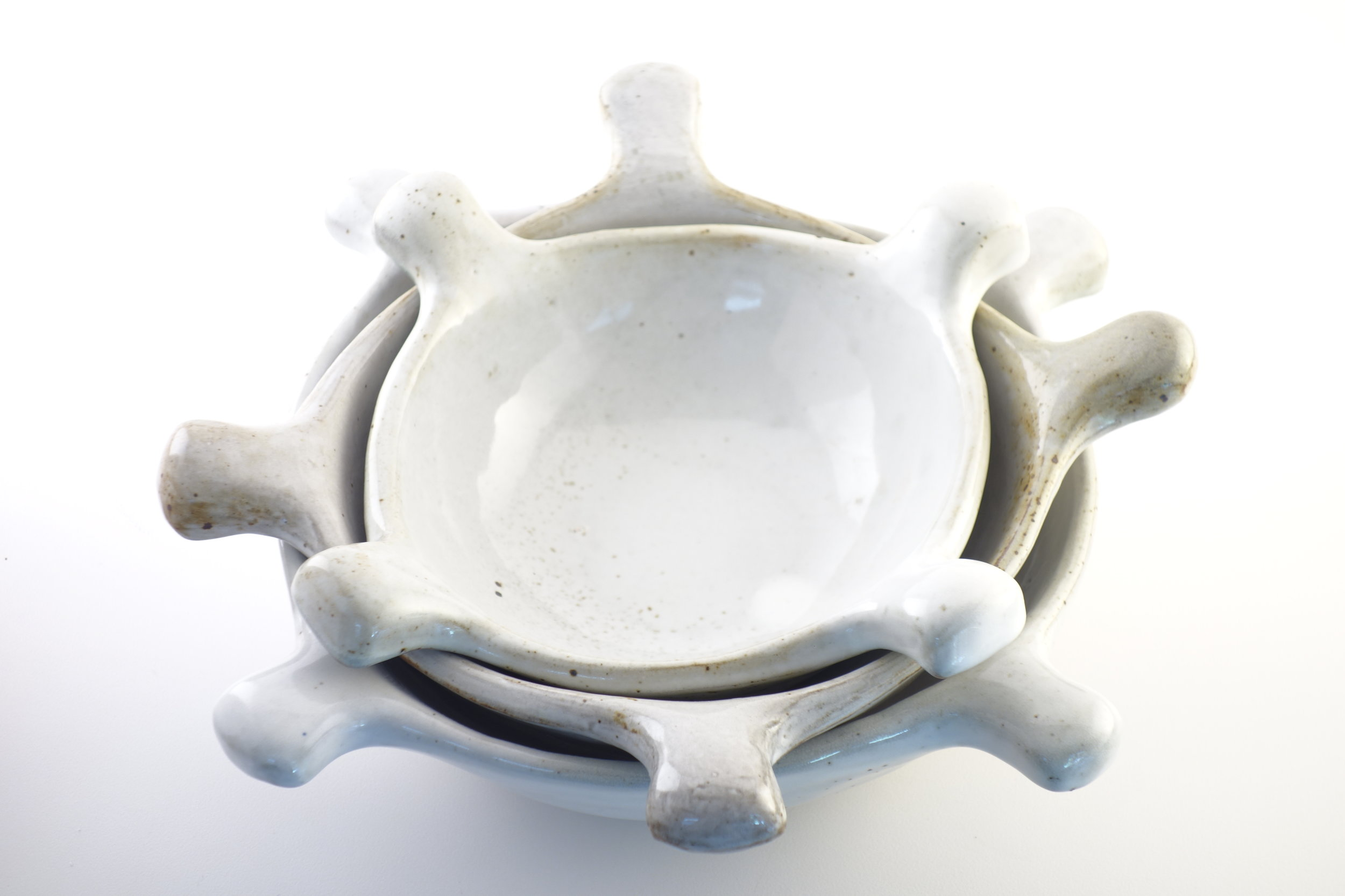 White Zinnia Stack   Three nesting bowls that mimic natures geometry. Stands alone as a sculptural form or opens on the table to serve food.  $200