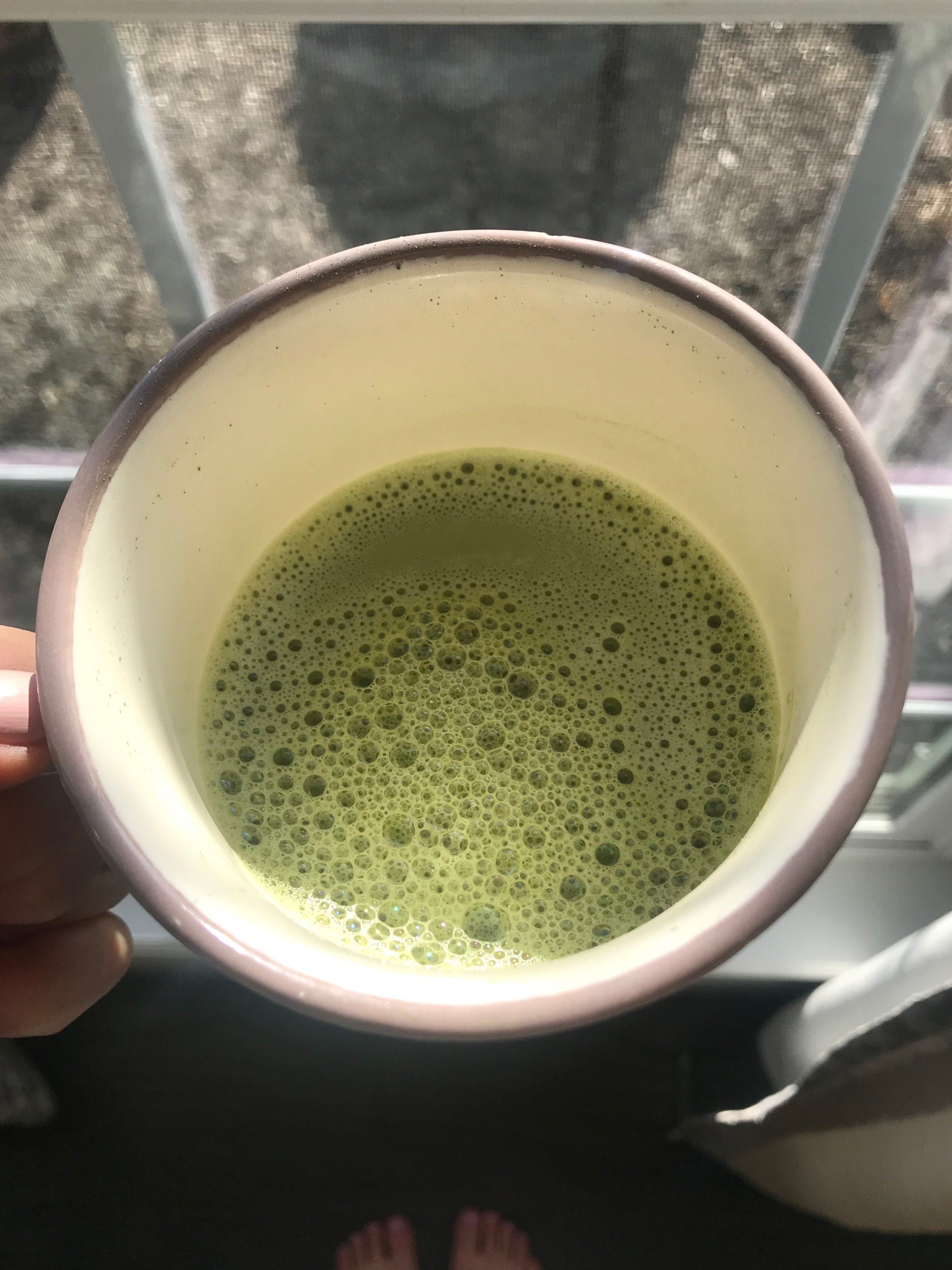 Matcha latte with almond milk, coconut butter, cinnamon, and collagen peptides