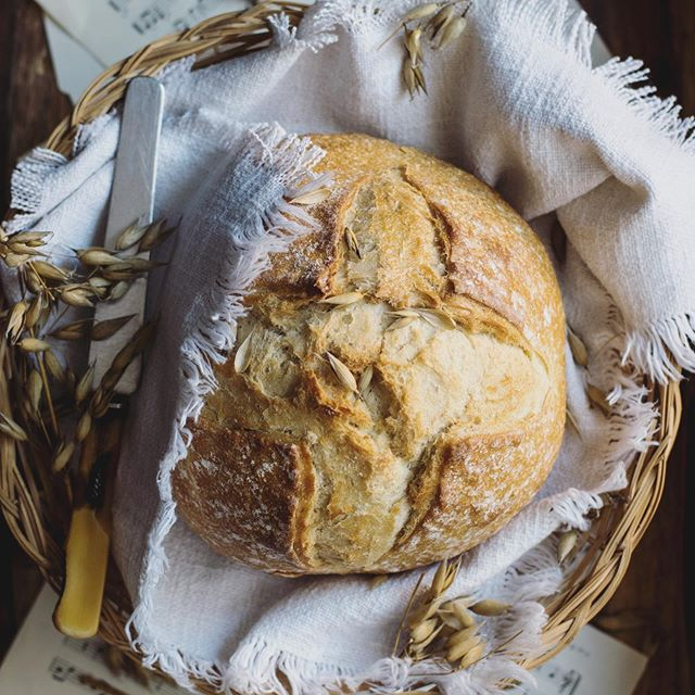 """Bread may not seem like a very mindful dietary choice, but it's time we take a closer look. - In our modern day, we see gluten as the enemy. The word """"gluten"""" itself evokes an onomatopoeic vision of sludgy goo that could swallow you up like quicksand. - But not all gluten is created equally! - What we think of as gluten today—the gluten that causes allergies and makes us feel bad—has been extracted and modified over many years. Since the 19th century when yeast was discovered under the microscope, us humans decided we could make things cheaper, faster, better. (We may have fallen short on that last one, though.) - Commercial yeast converts grain sugars and starches into carbon dioxide to create air pockets that allow the dough to rise. Whereas sourdough starter contains natural bacteria that converts proteins into lactic acid. In both cases, the gluten creates those pocket for that bacteria to off gas and that's how it gets nice and fluffy. - Are you starting to see how maybe it's not the gluten's fault that we feel bad? - I'd pretty much written off bread several years ago when a friend introduced me to homemade sourdough bread and gave me some of her starter. I was surprised to find I didn't feel bad after eating it—even for weeks on end! I now bake sourdough bread almost weekly. And if not a bread loaf, then sourdough pancakes or pizza dough. - The process itself is a mindful one—taking care of the starter, creating the dough and waiting for it to rise overnight, and then baking it in the oven to enjoy. It's not fast, but it's cheap and most definitely better! - So before you write bread off completely, consider trying sourdough. And if you like it, consider adding bread making to your list of mindful activities! - #mindfulmonday #sourdoughbread #baking #mindfulness"""