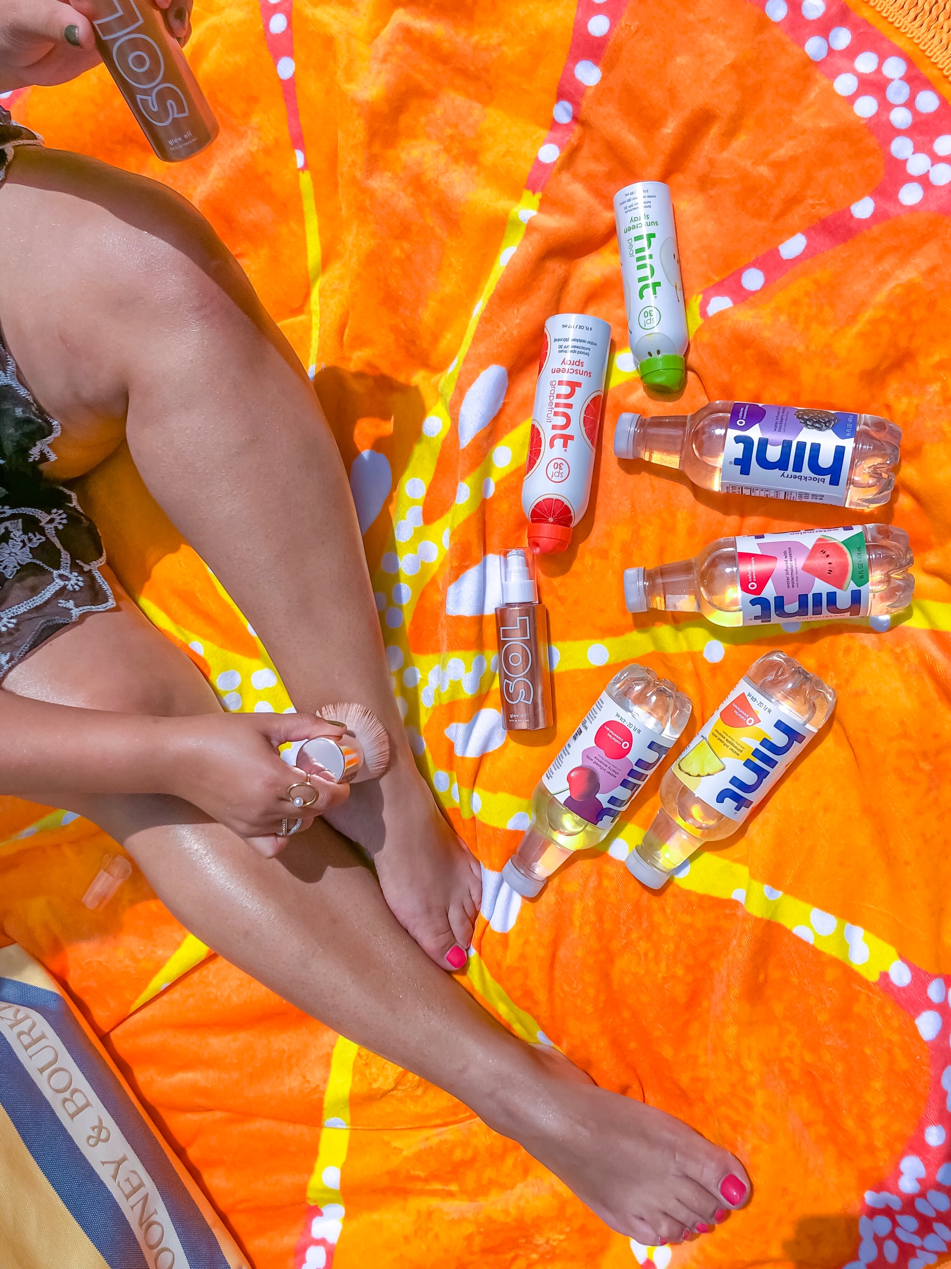 Hint water assorted flavors and their new sunscreen in pear & pineapple scents