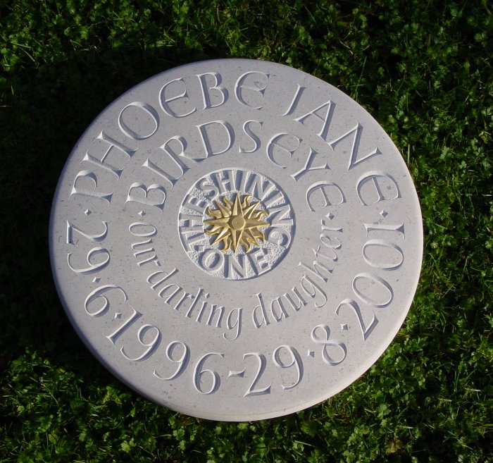 Raised and incised lettering with relief carving
