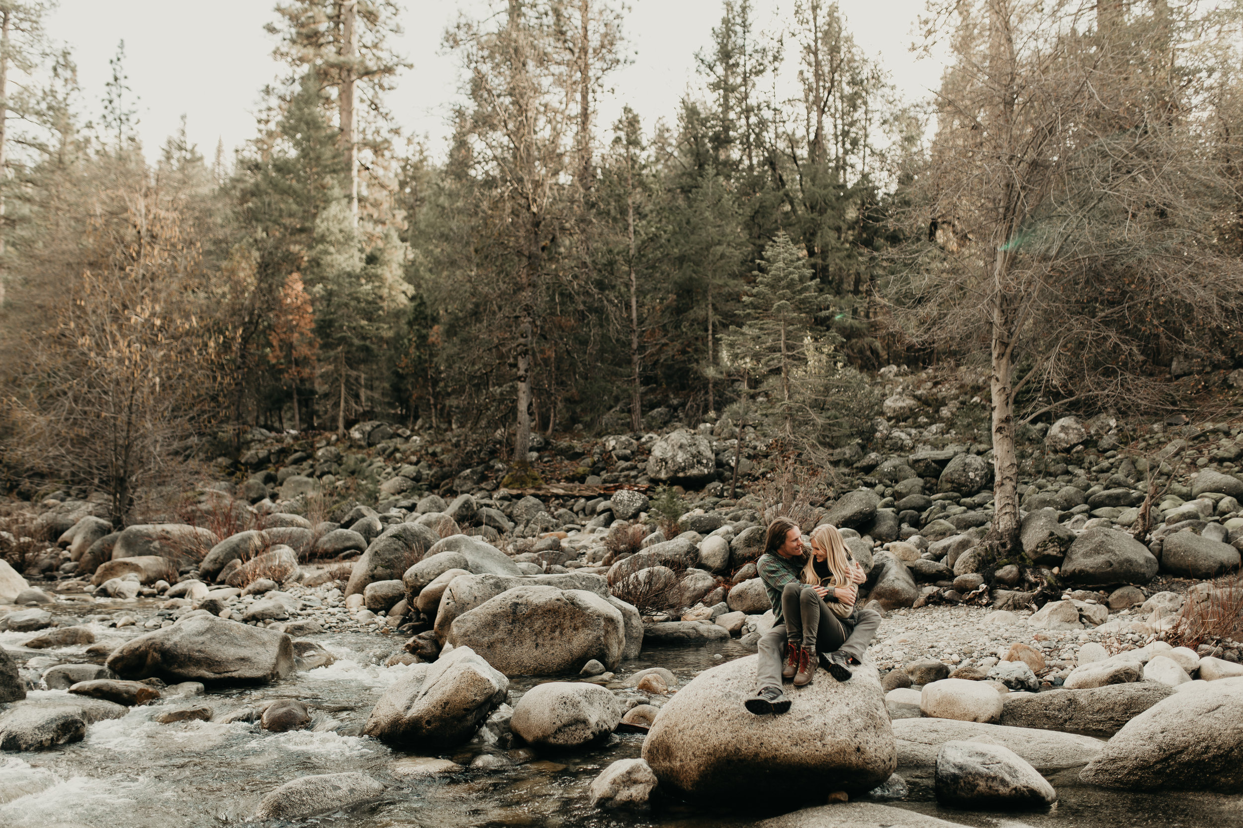 nicole-daacke-photography-yosemite-riverside-adventurous-engagement-photos-in-yosemite-national-park-elopement-photographer-weddings-travel-destination-wedding-eloping-elope-pine-forest-16.jpg