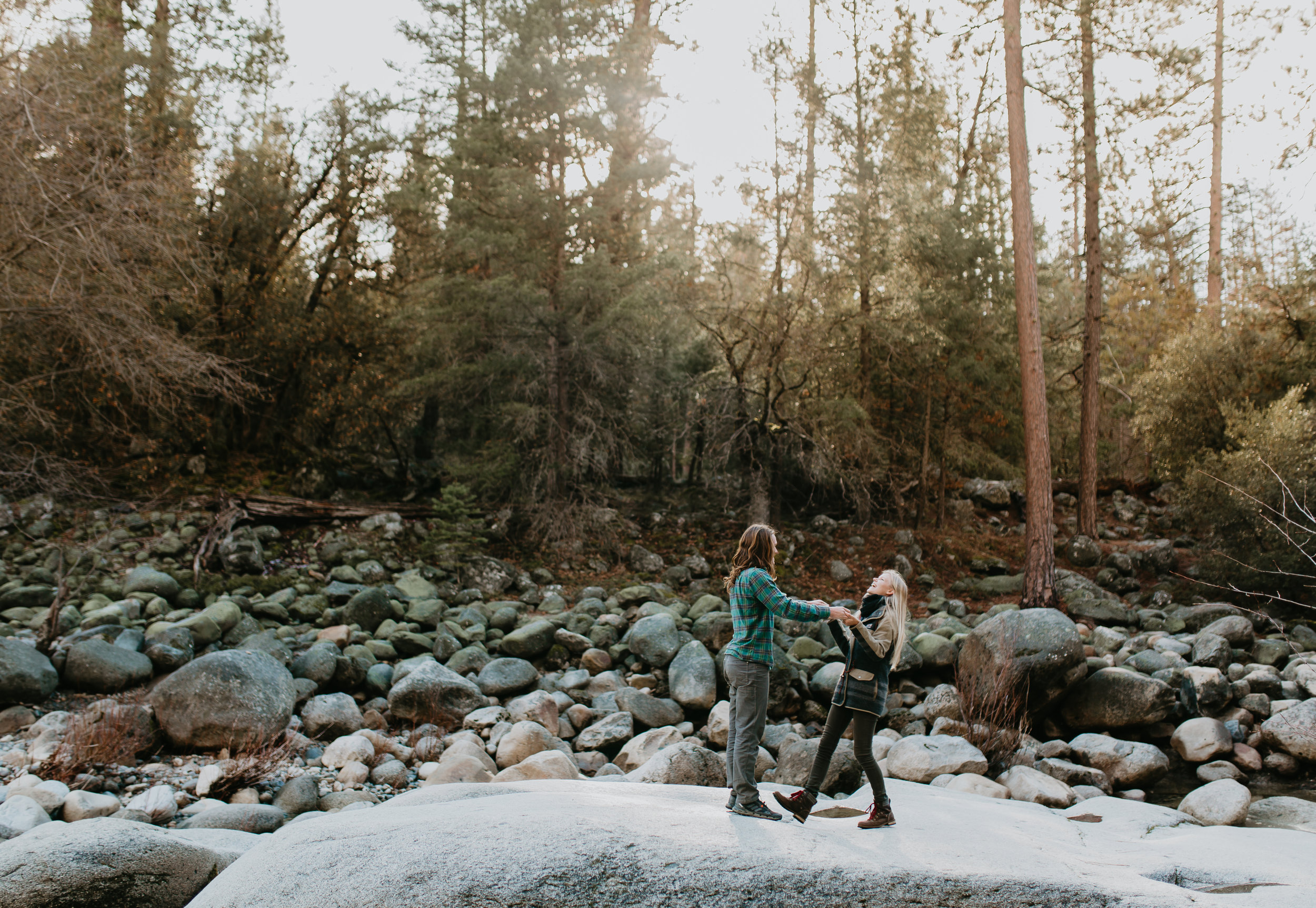 nicole-daacke-photography-yosemite-riverside-adventurous-engagement-photos-in-yosemite-national-park-elopement-photographer-weddings-travel-destination-wedding-eloping-elope-pine-forest-18.jpg