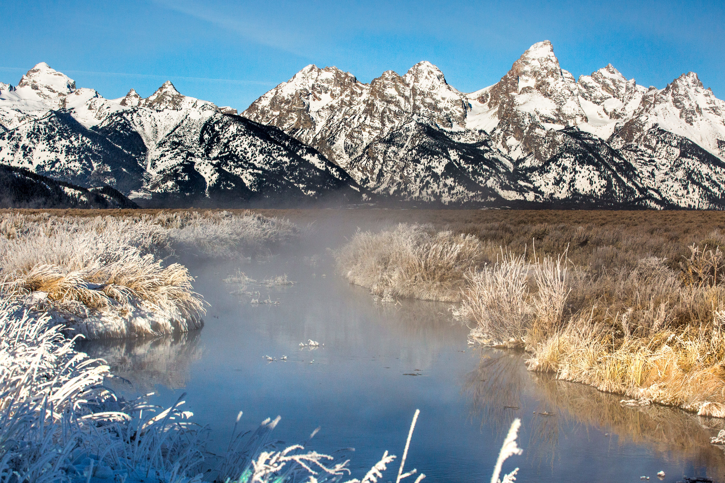 nicole-daacke-photography-jackson-hole-grand-teton-national-park-elopement-wedding-photographer-adventurous-engagement-session-grand-tetons-snow-visit-itinerary-for-jackson-hole-wyoming-9736.jpg