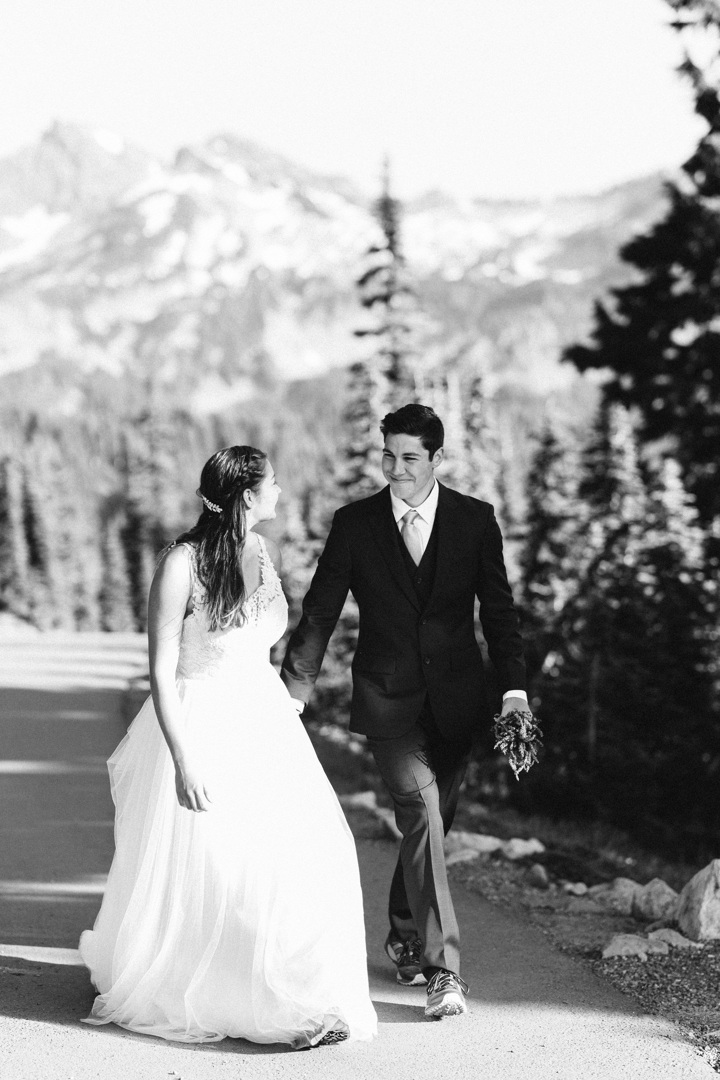 Nicole-Daacke-Photography-Mt-Rainier-elopement-photographer-washington-mountain-epic-wedding-photography-wildflowers-at-rainier-pine-tree-cloudy-summer-day-at-mountain-rainier-4.jpg