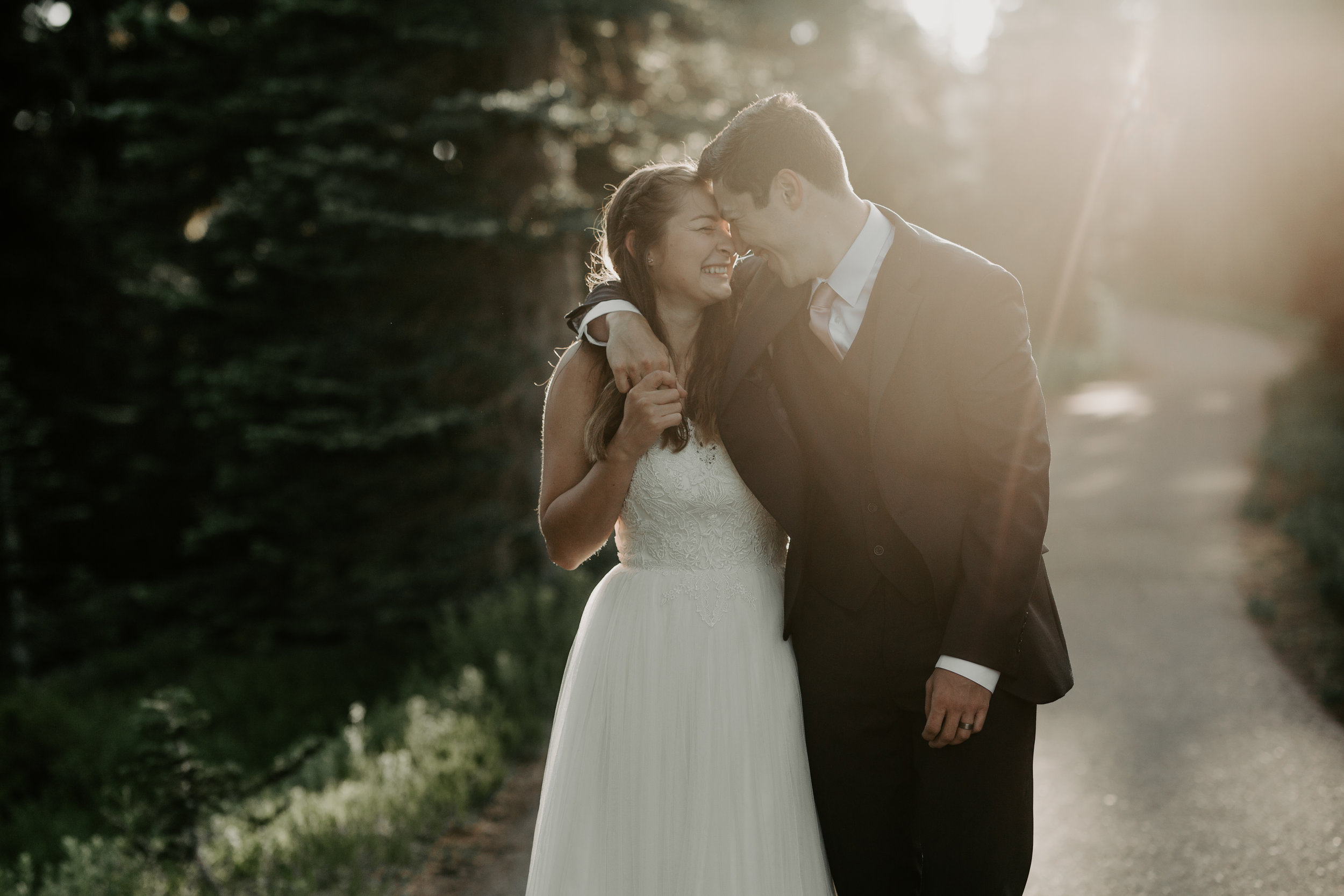 Nicole-Daacke-Photography-Mt-Rainier-elopement-photographer-washington-mountain-epic-wedding-photography-wildflowers-at-rainier-pine-tree-cloudy-summer-day-at-mountain-rainier-22.jpg