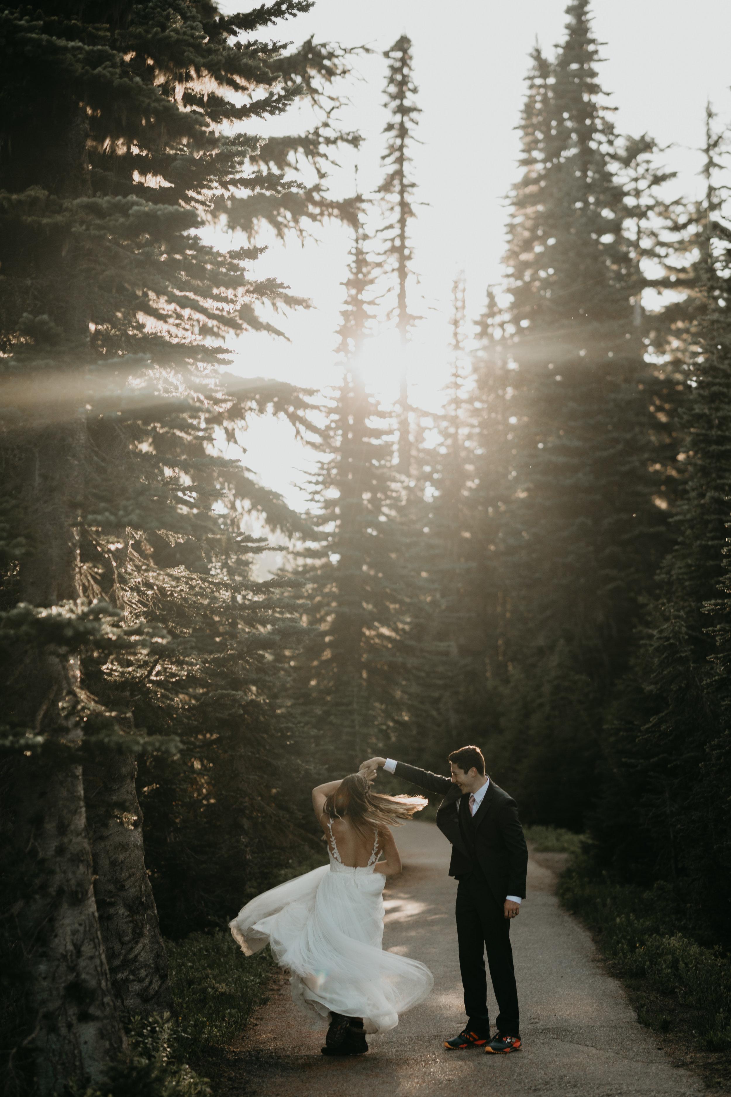 Nicole-Daacke-Photography-Mt-Rainier-elopement-photographer-washington-mountain-epic-wedding-photography-wildflowers-at-rainier-pine-tree-cloudy-summer-day-at-mountain-rainier-25.jpg