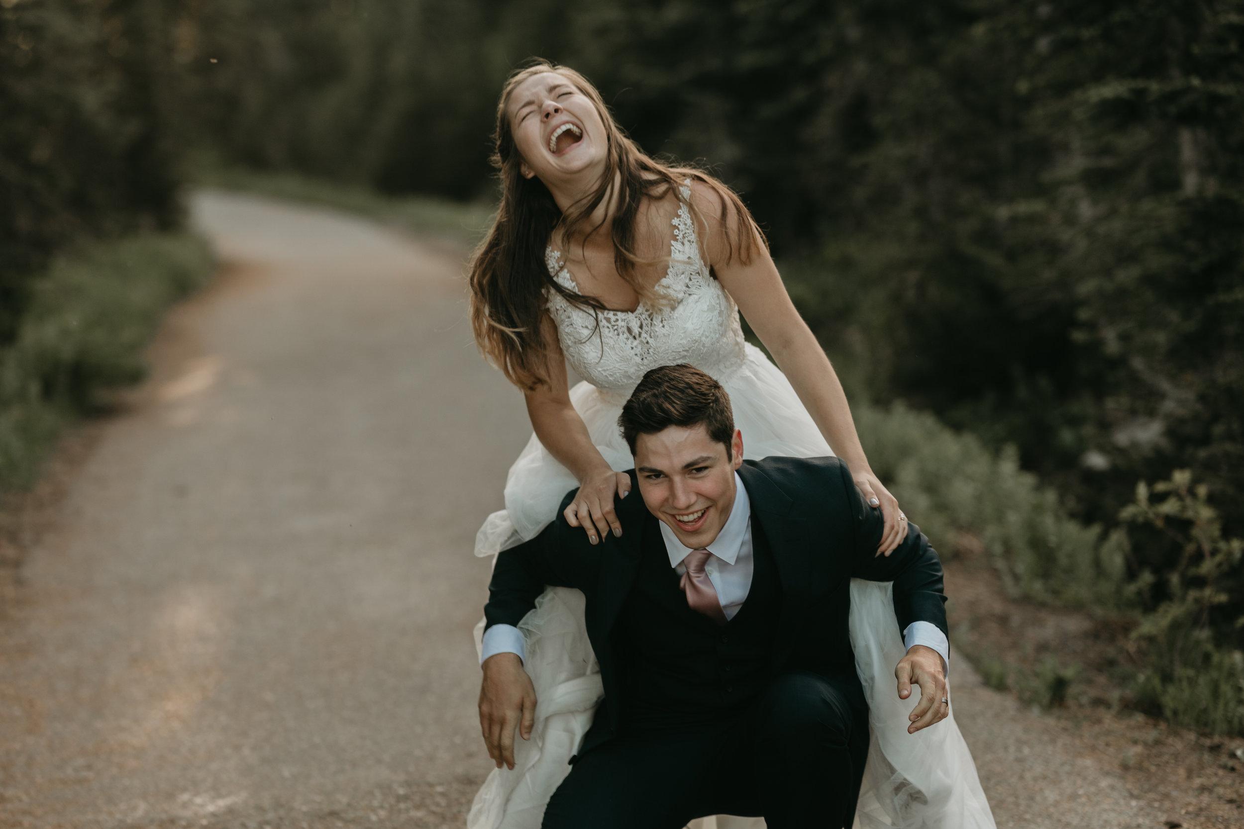 Nicole-Daacke-Photography-Mt-Rainier-elopement-photographer-washington-mountain-epic-wedding-photography-wildflowers-at-rainier-pine-tree-cloudy-summer-day-at-mountain-rainier-29.jpg