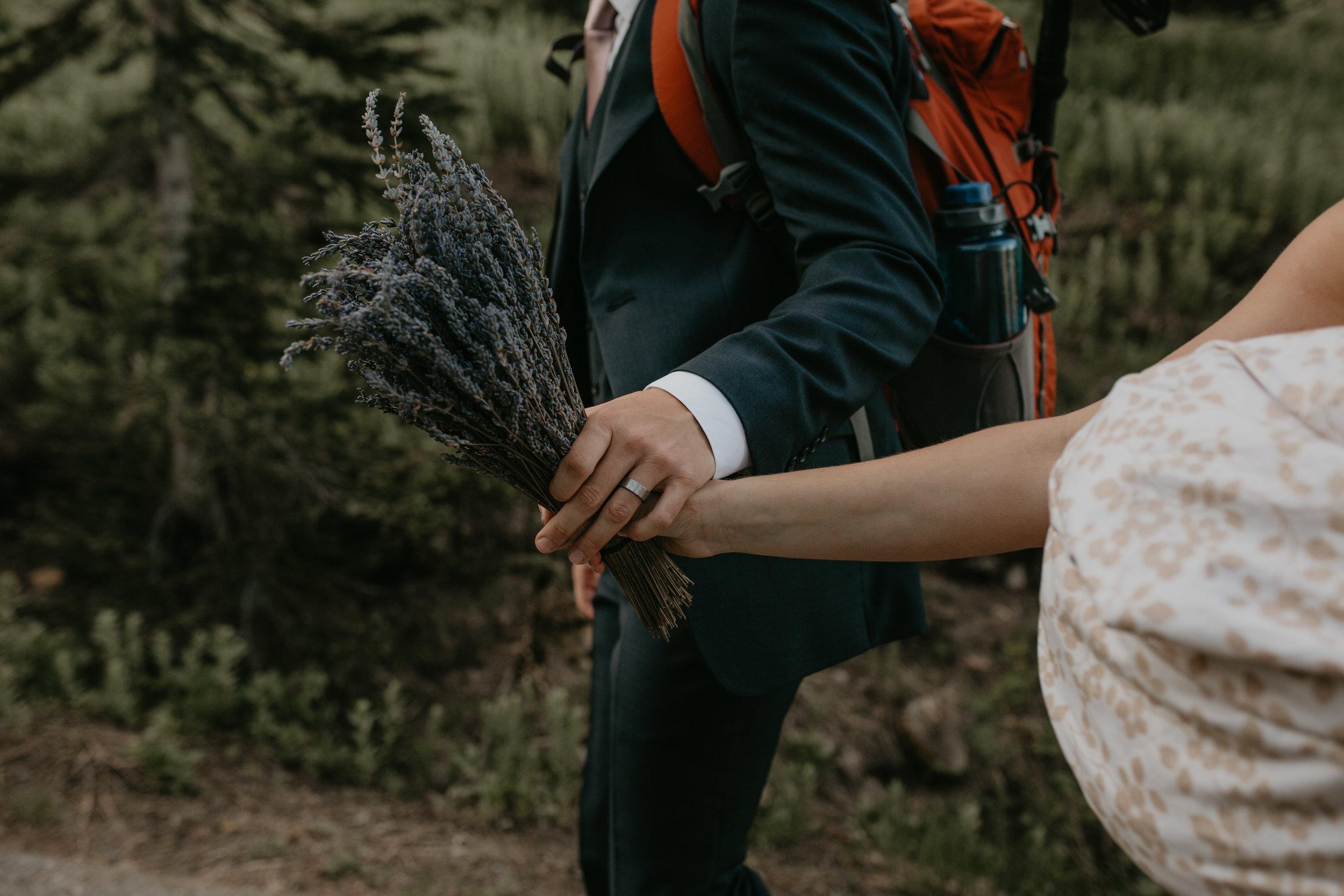 Nicole-Daacke-Photography-Mt-Rainier-elopement-photographer-washington-mountain-epic-wedding-photography-wildflowers-at-rainier-pine-tree-cloudy-summer-day-at-mountain-rainier-36.jpg