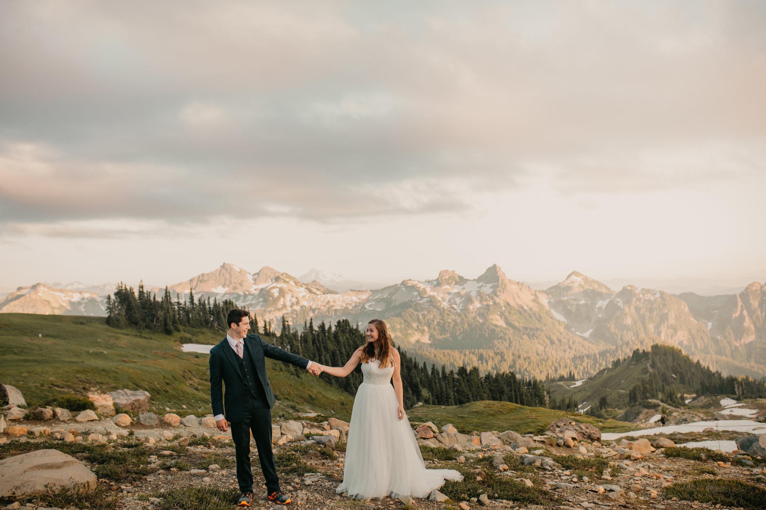 Nicole-Daacke-Photography-Mt-Rainier-elopement-photographer-washington-mountain-epic-wedding-photography-wildflowers-at-rainier-pine-tree-cloudy-summer-day-at-mountain-rainier-43.jpg