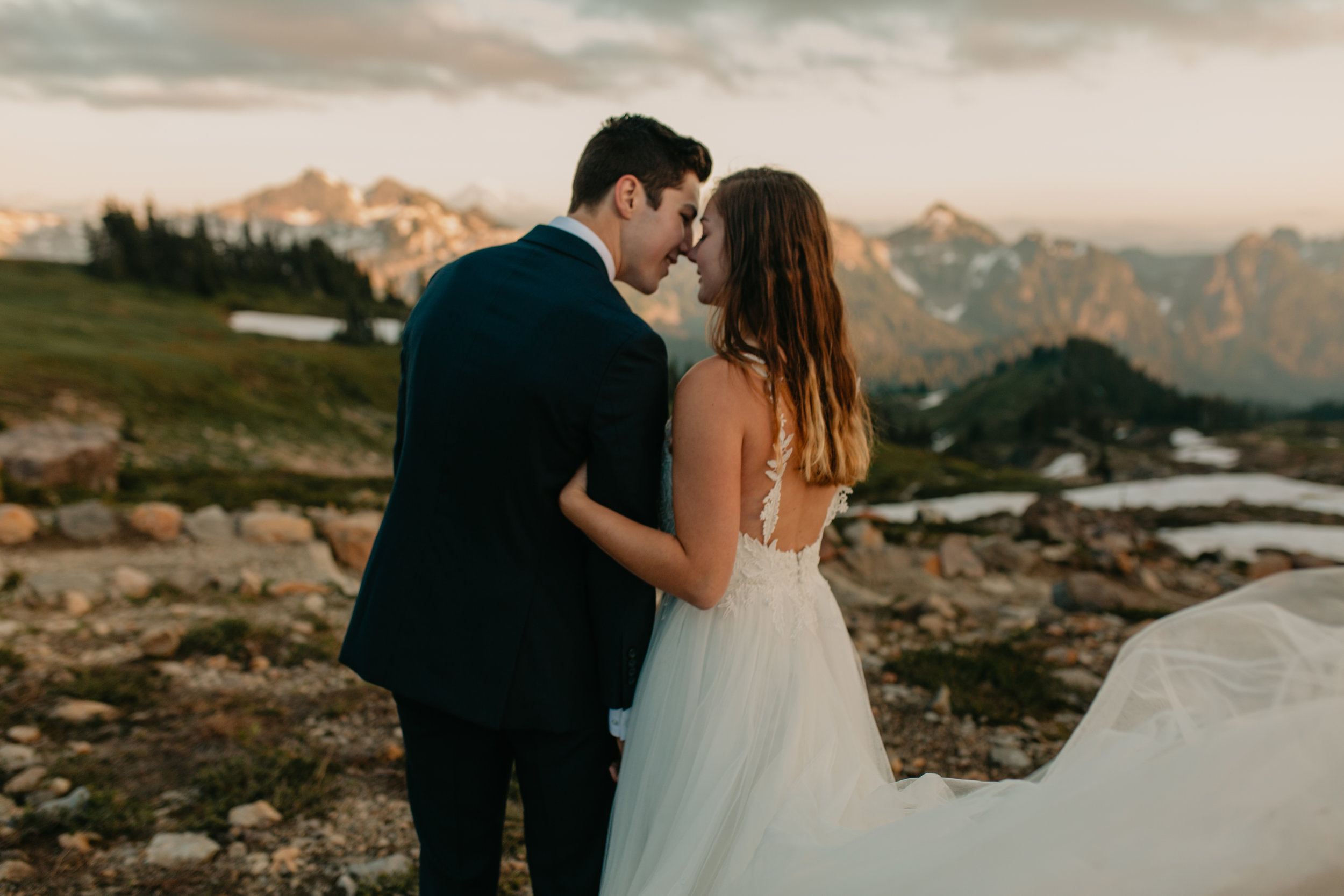 Nicole-Daacke-Photography-Mt-Rainier-elopement-photographer-washington-mountain-epic-wedding-photography-wildflowers-at-rainier-pine-tree-cloudy-summer-day-at-mountain-rainier-46.jpg