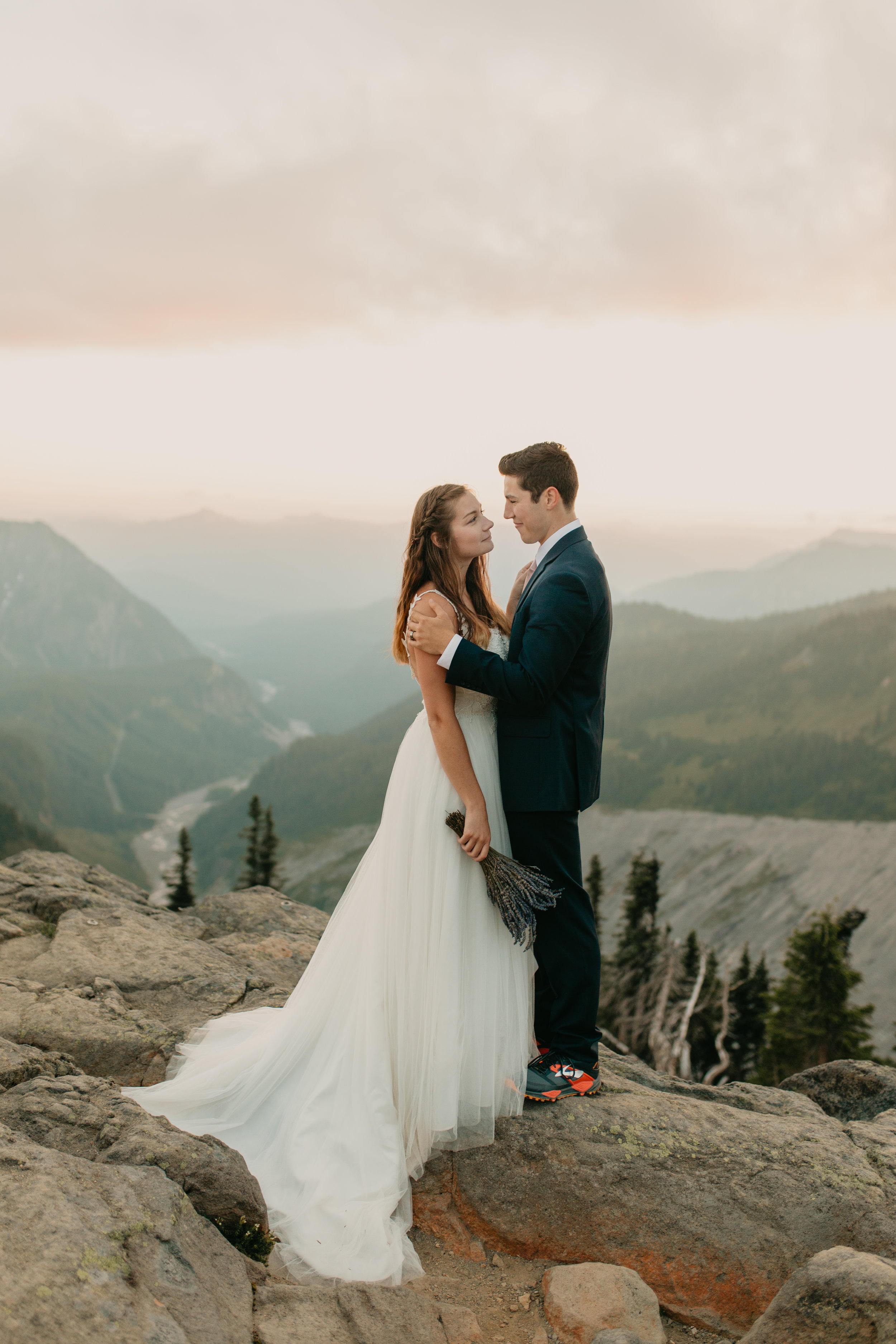 Nicole-Daacke-Photography-Mt-Rainier-elopement-photographer-washington-mountain-epic-wedding-photography-wildflowers-at-rainier-pine-tree-cloudy-summer-day-at-mountain-rainier-53.jpg