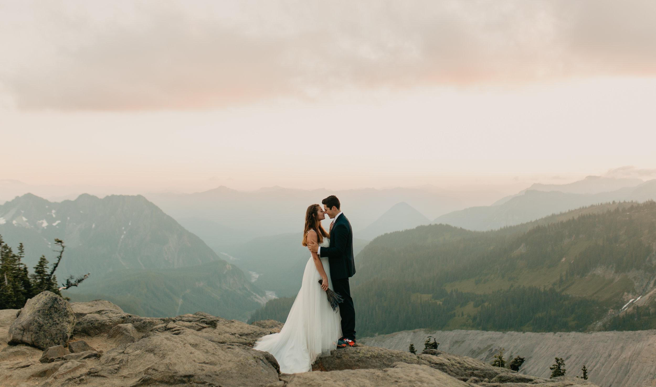 Nicole-Daacke-Photography-Mt-Rainier-elopement-photographer-washington-mountain-epic-wedding-photography-wildflowers-at-rainier-pine-tree-cloudy-summer-day-at-mountain-rainier-54.jpg