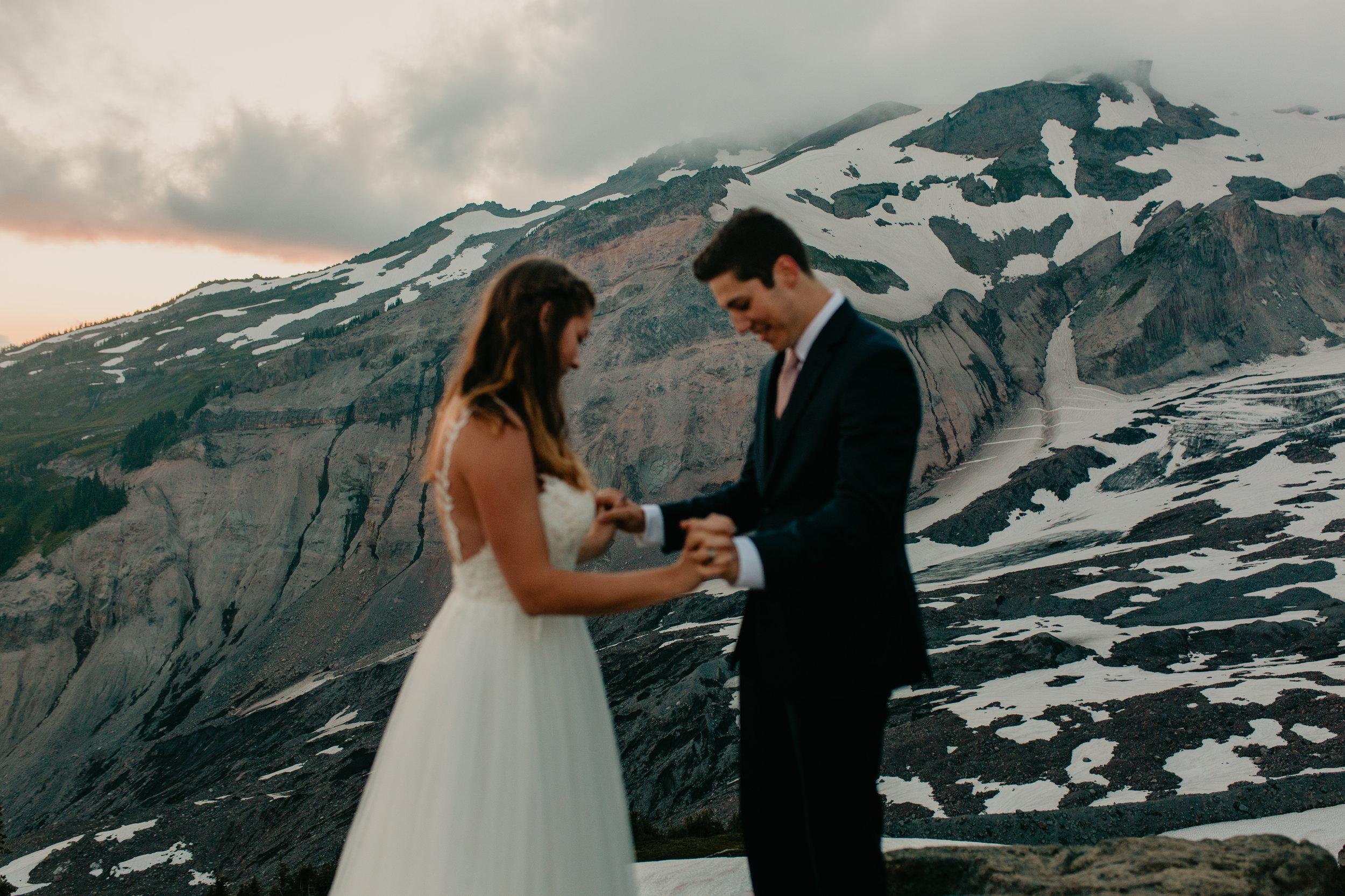 Nicole-Daacke-Photography-Mt-Rainier-elopement-photographer-washington-mountain-epic-wedding-photography-wildflowers-at-rainier-pine-tree-cloudy-summer-day-at-mountain-rainier-62.jpg
