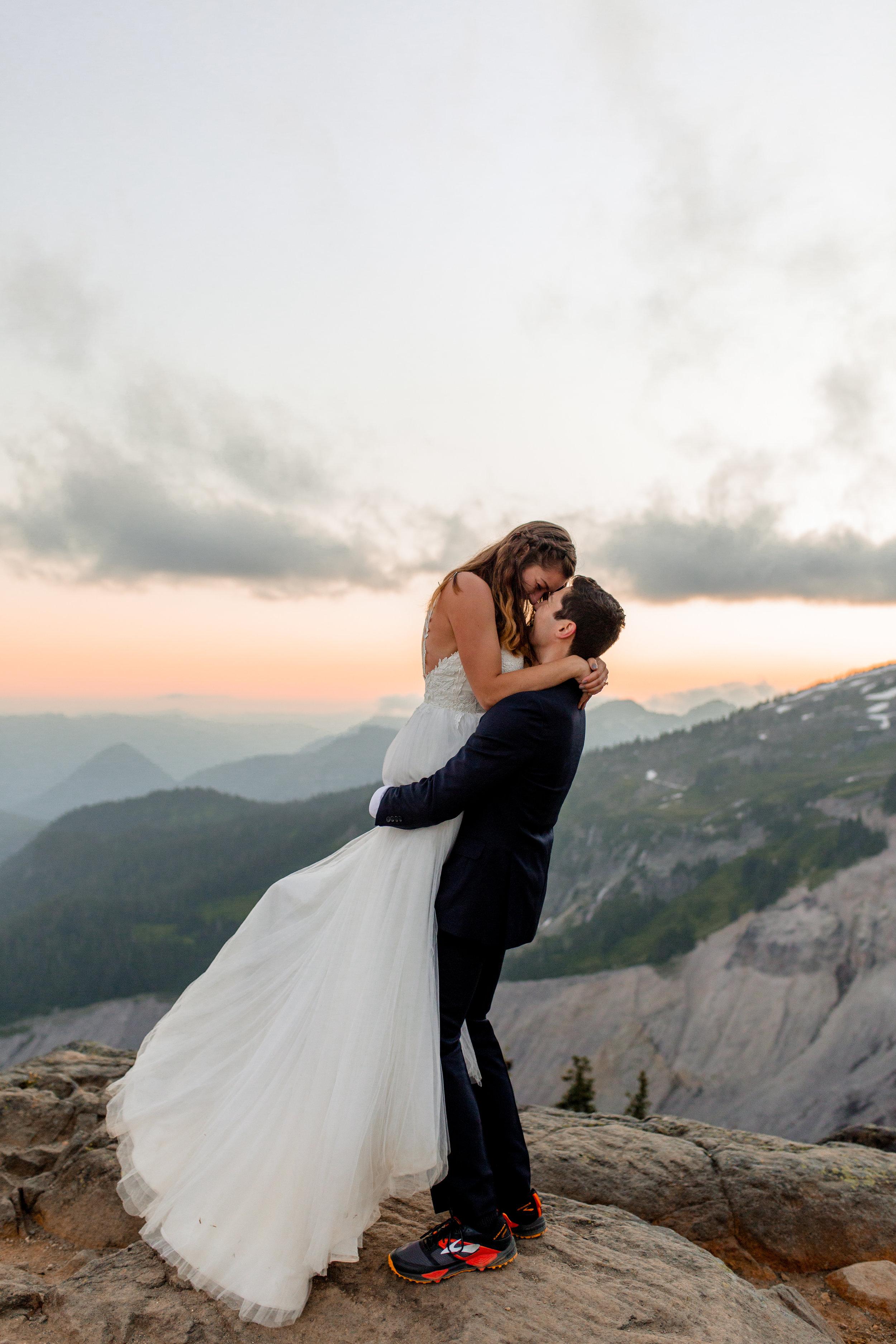 Nicole-Daacke-Photography-Mt-Rainier-elopement-photographer-washington-mountain-epic-wedding-photography-wildflowers-at-rainier-pine-tree-cloudy-summer-day-at-mountain-rainier-64.jpg