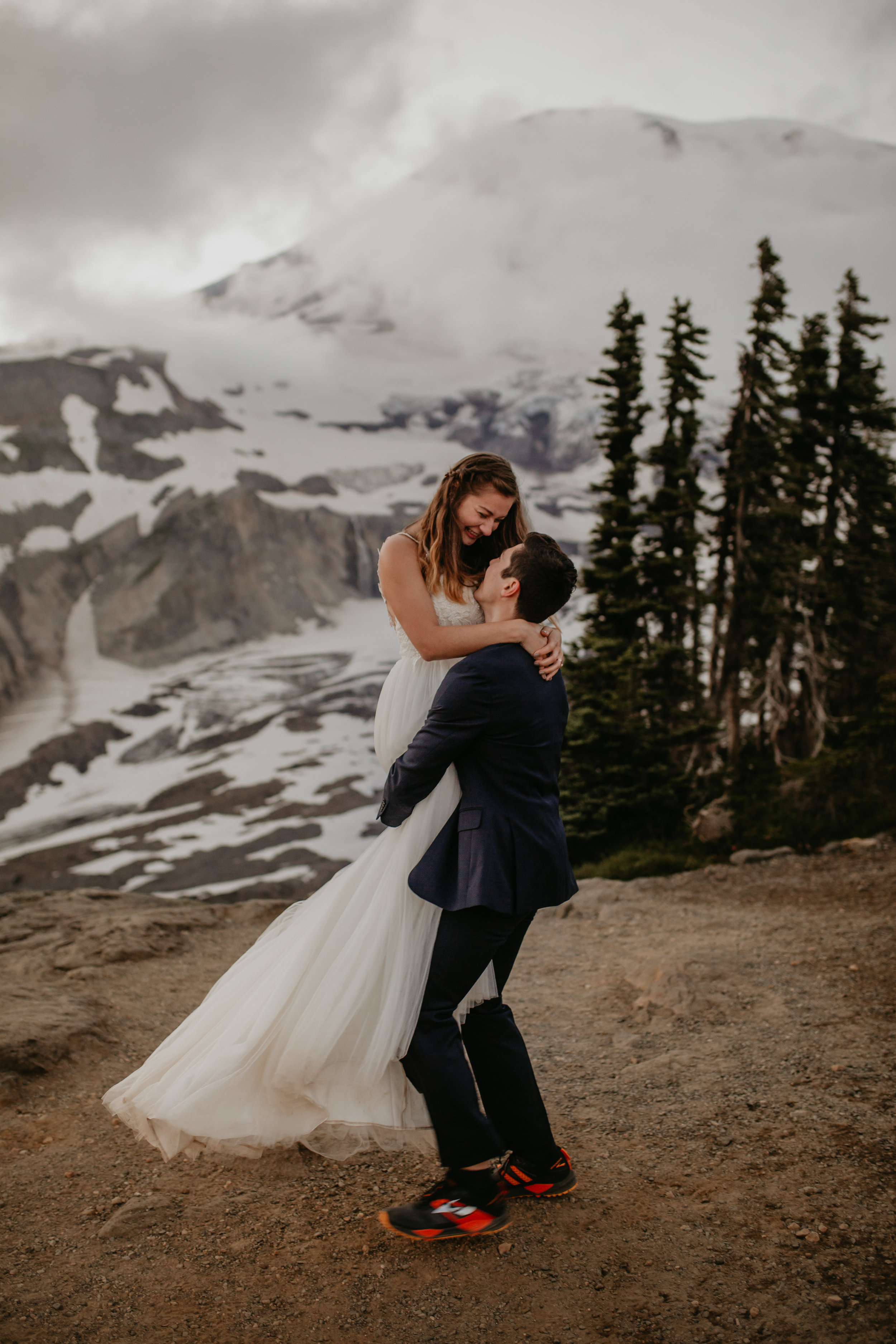 Nicole-Daacke-Photography-Mt-Rainier-elopement-photographer-washington-mountain-epic-wedding-photography-wildflowers-at-rainier-pine-tree-cloudy-summer-day-at-mountain-rainier-68.jpg